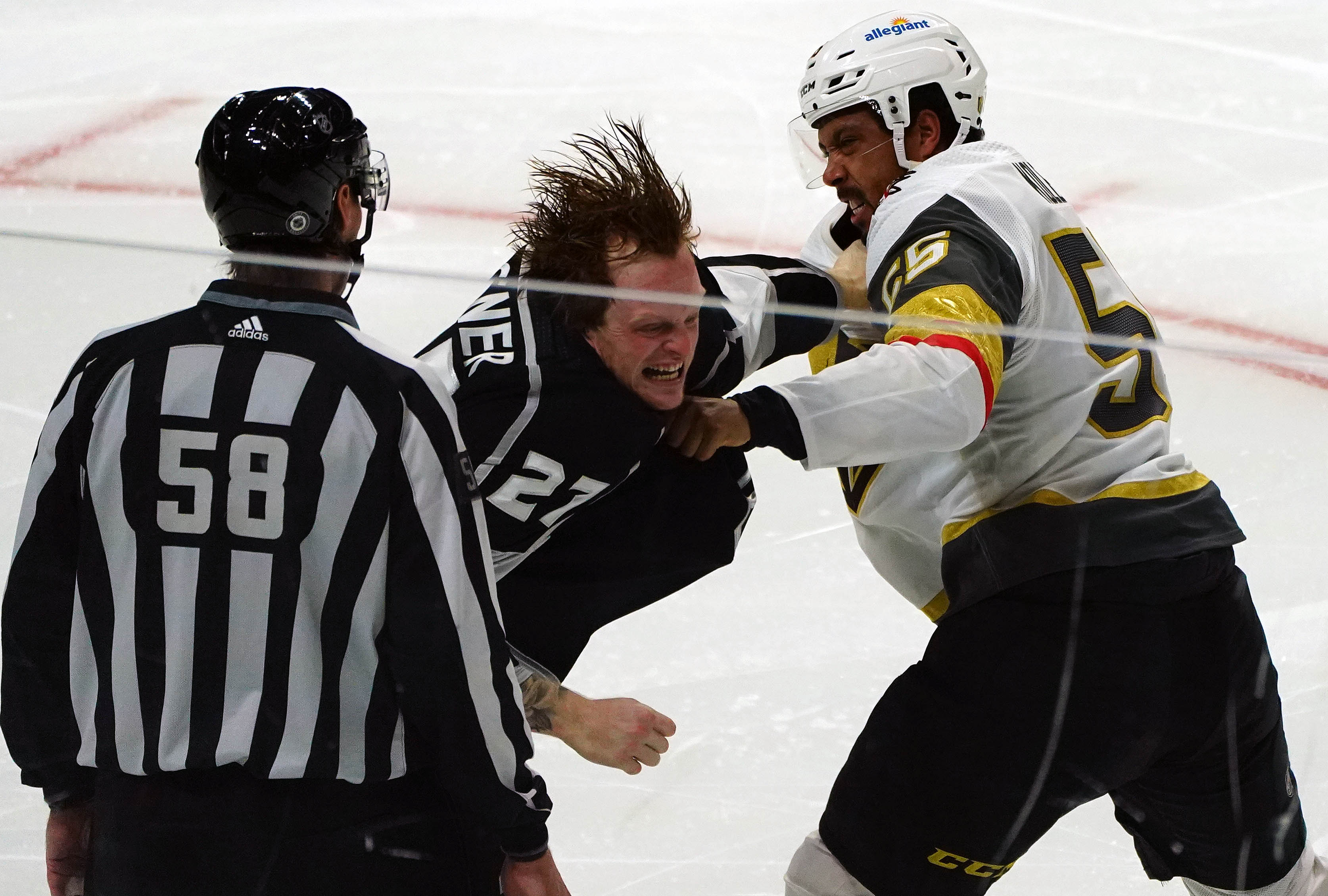 Los Angeles Kings left wing Austin Wagner (27) fights against Vegas Golden Knights right wing Keegan Kolesar (55) during the second period at Staples Center.