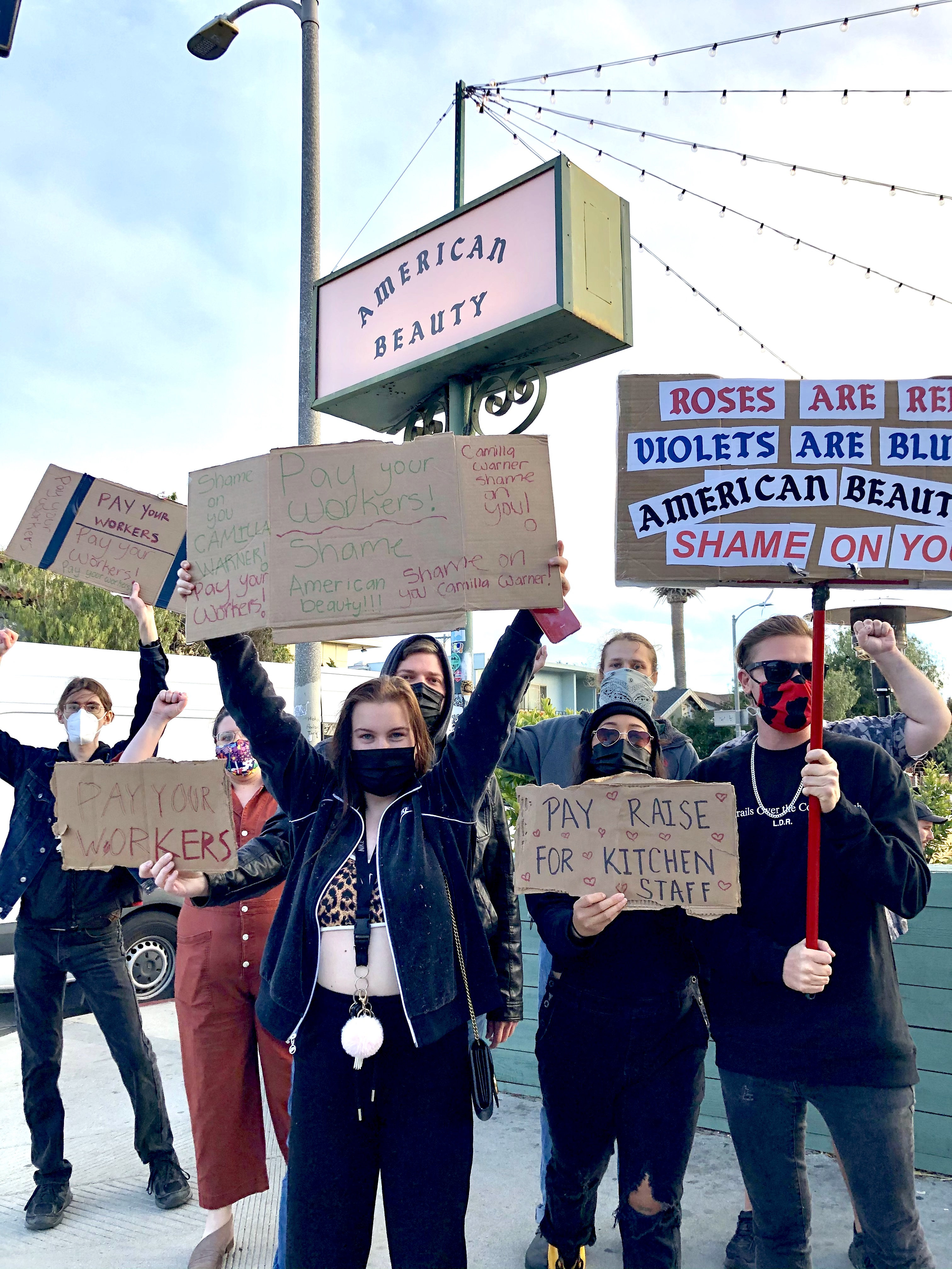 American Beauty servers protesting outside the Venice restaurant on March 19, 2021.