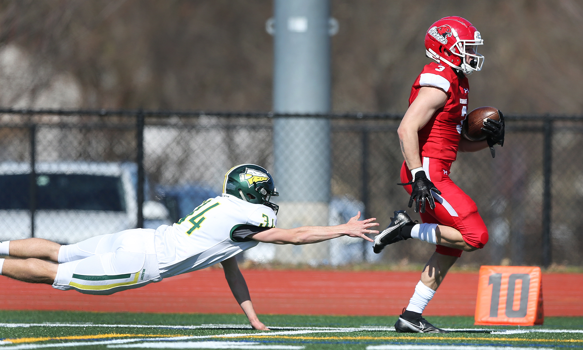 Naperville Central's Antonio Torres (3) is just out of the reach of Waubonsie Valley's Jacob Razo (34).