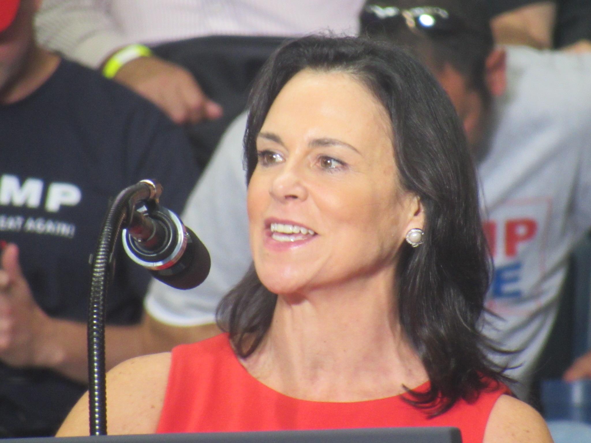 Jane Timken speaks into a microphone.