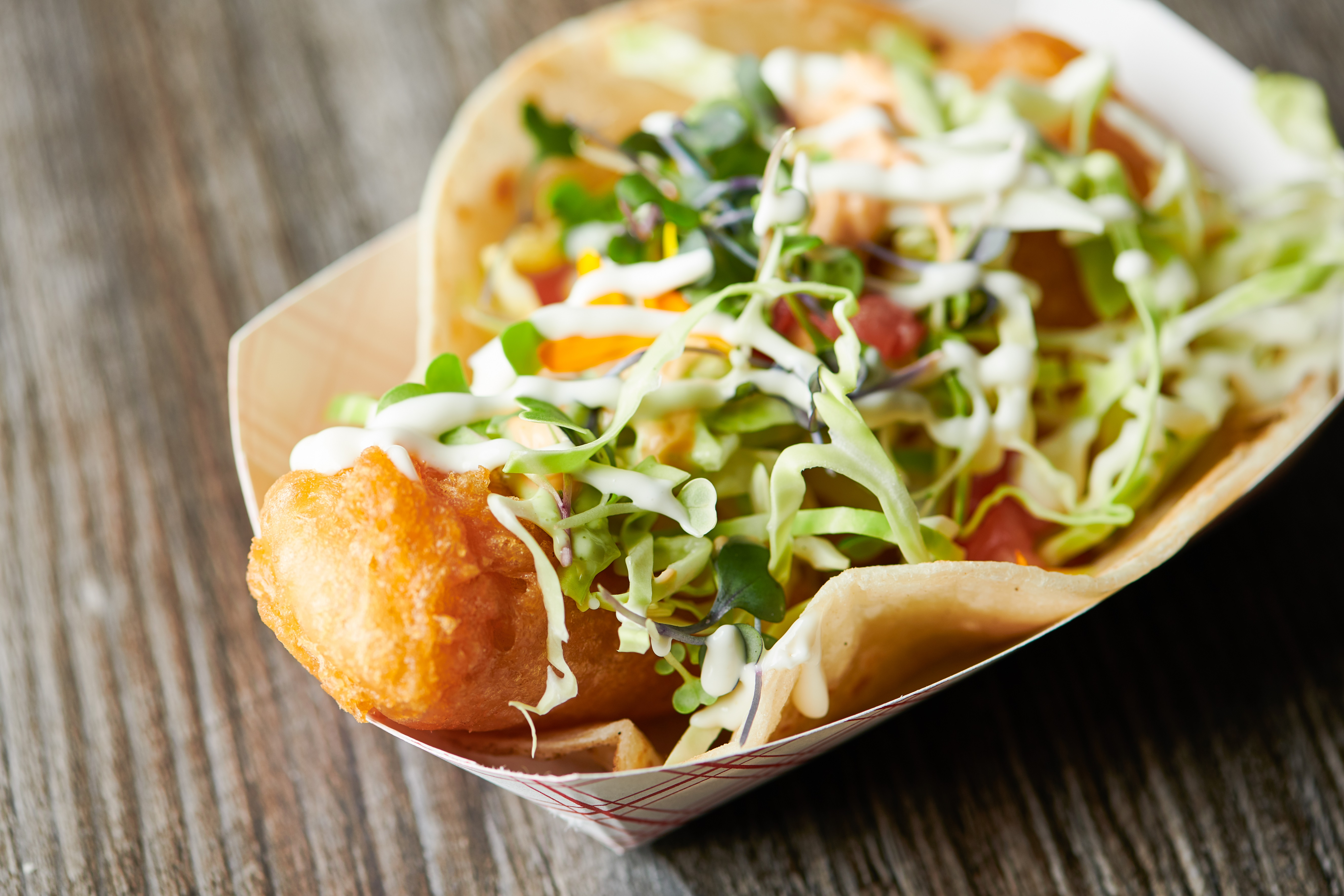 Beer-battered fish taco made with Mike Hess Brewing beer from Quiero Taco in Seaport Village