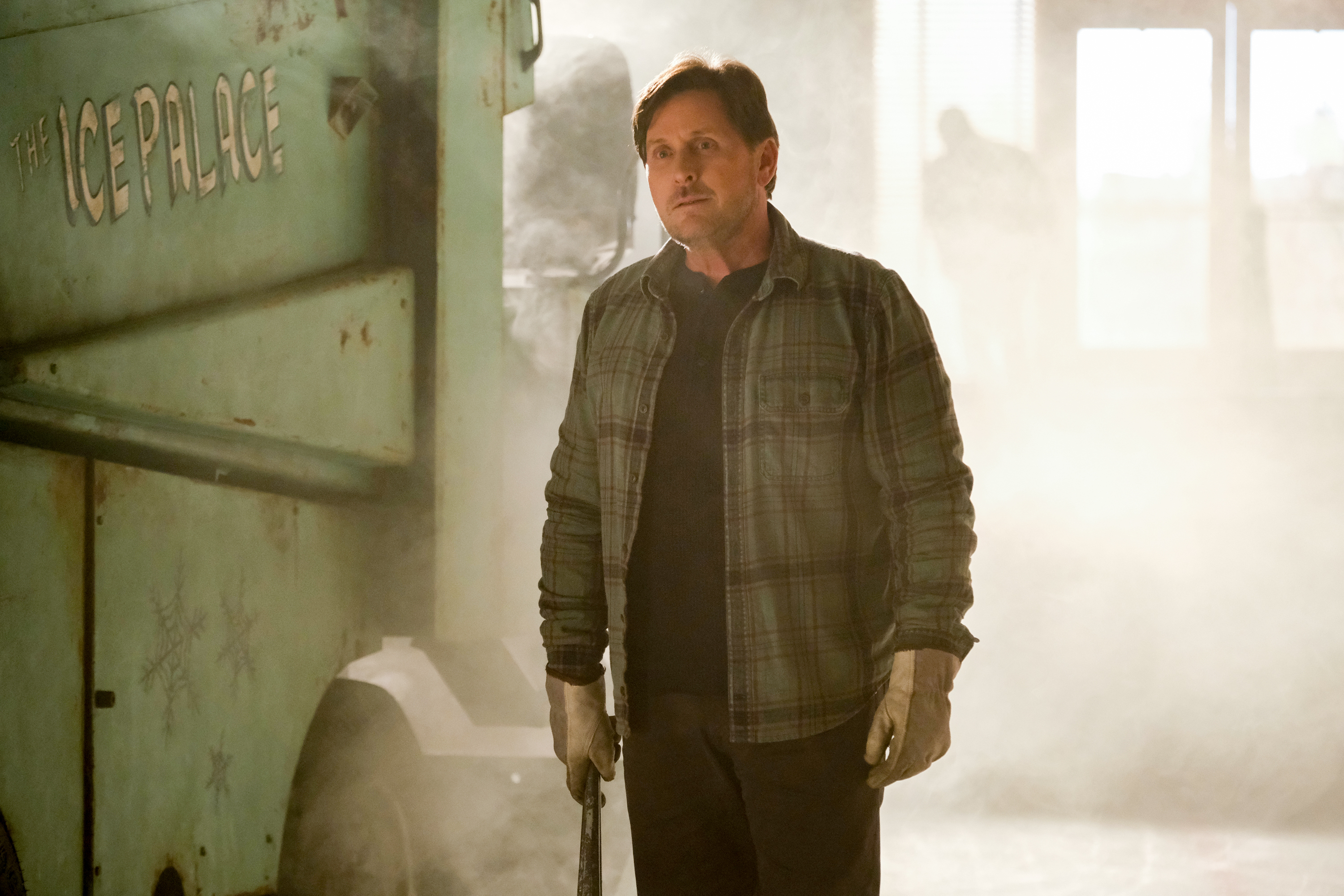 Emilio Estevez, looking scruffy and tired standing by his Zamboni in Mighty Ducks: Game Changers
