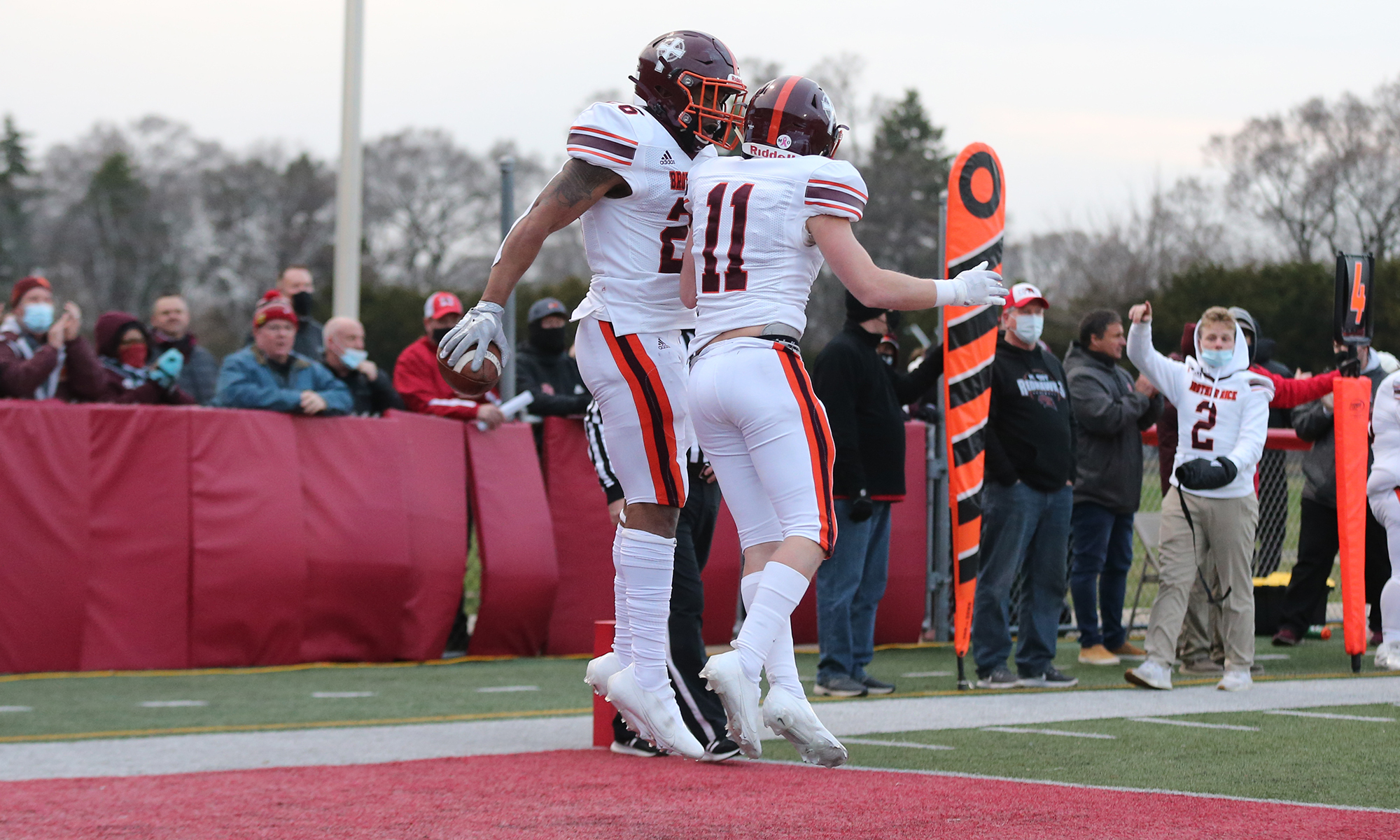 Brother Rice's Willie Shaw (26) celebrates his touchdown with Collin McGlynn (11).