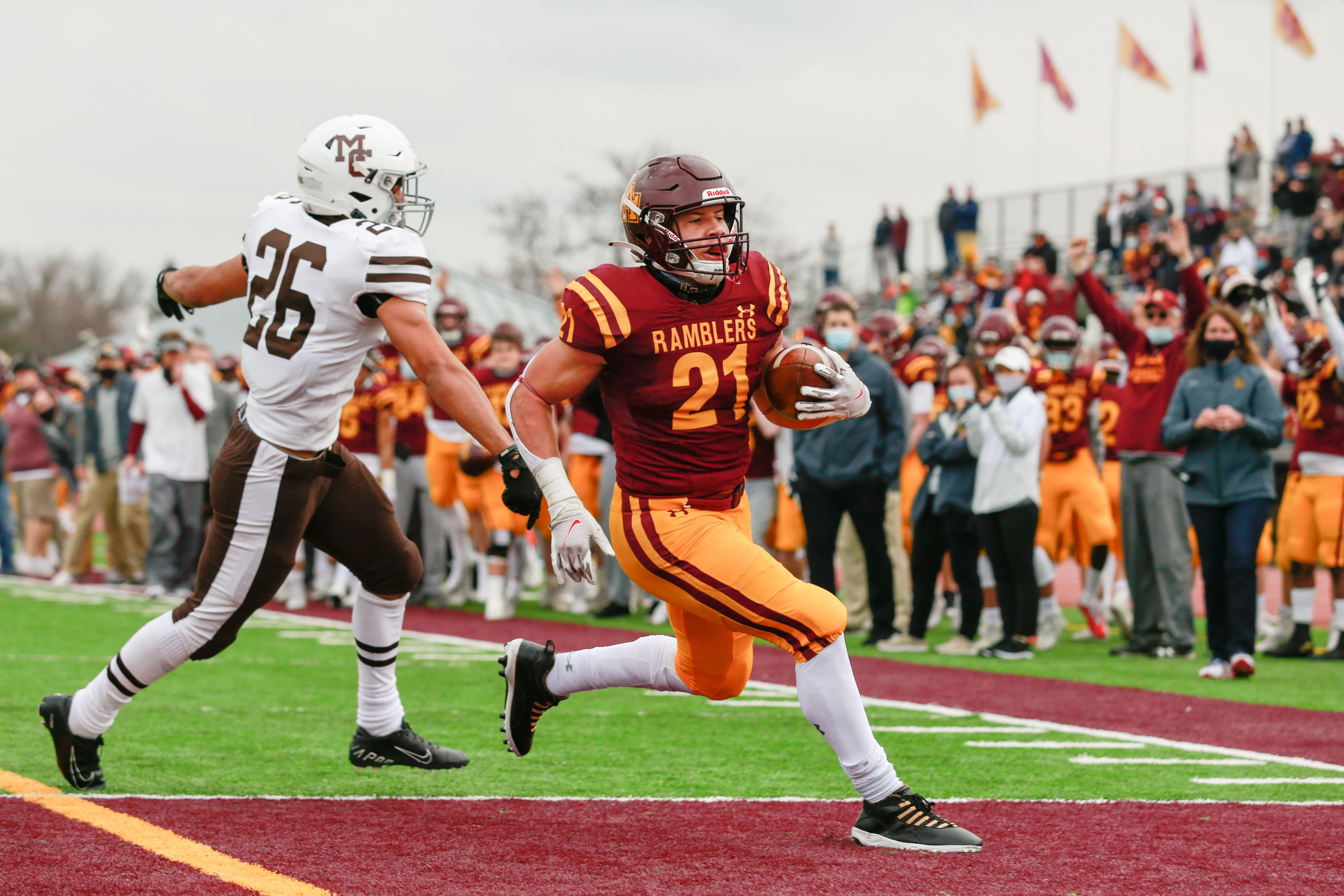 Loyola's Vaughn Pemberton (21) scores a touchdown against Mount Carmel.