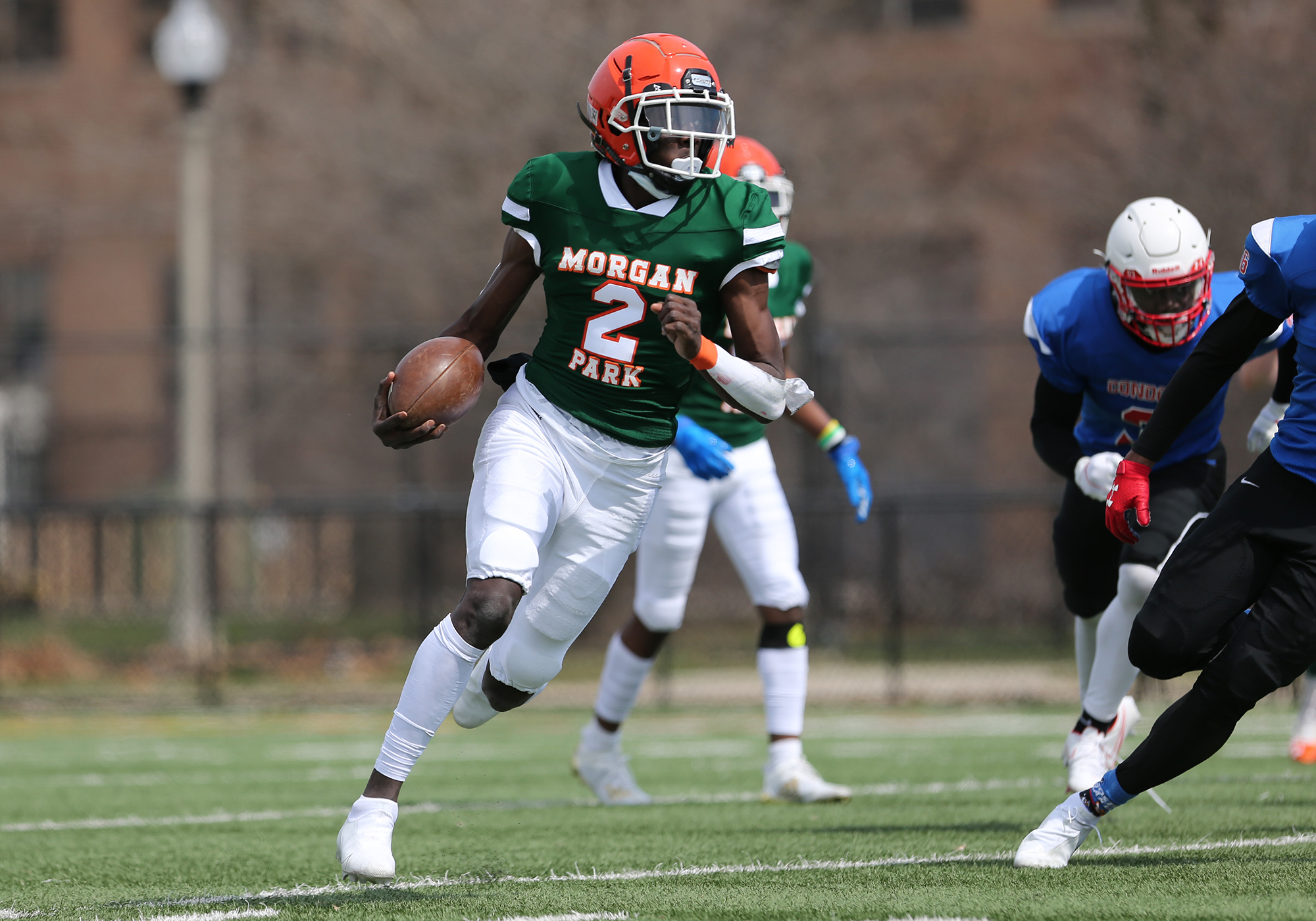 Morgan Park's Aaron Warren (2) tucks the ball and decides to run against Curie.