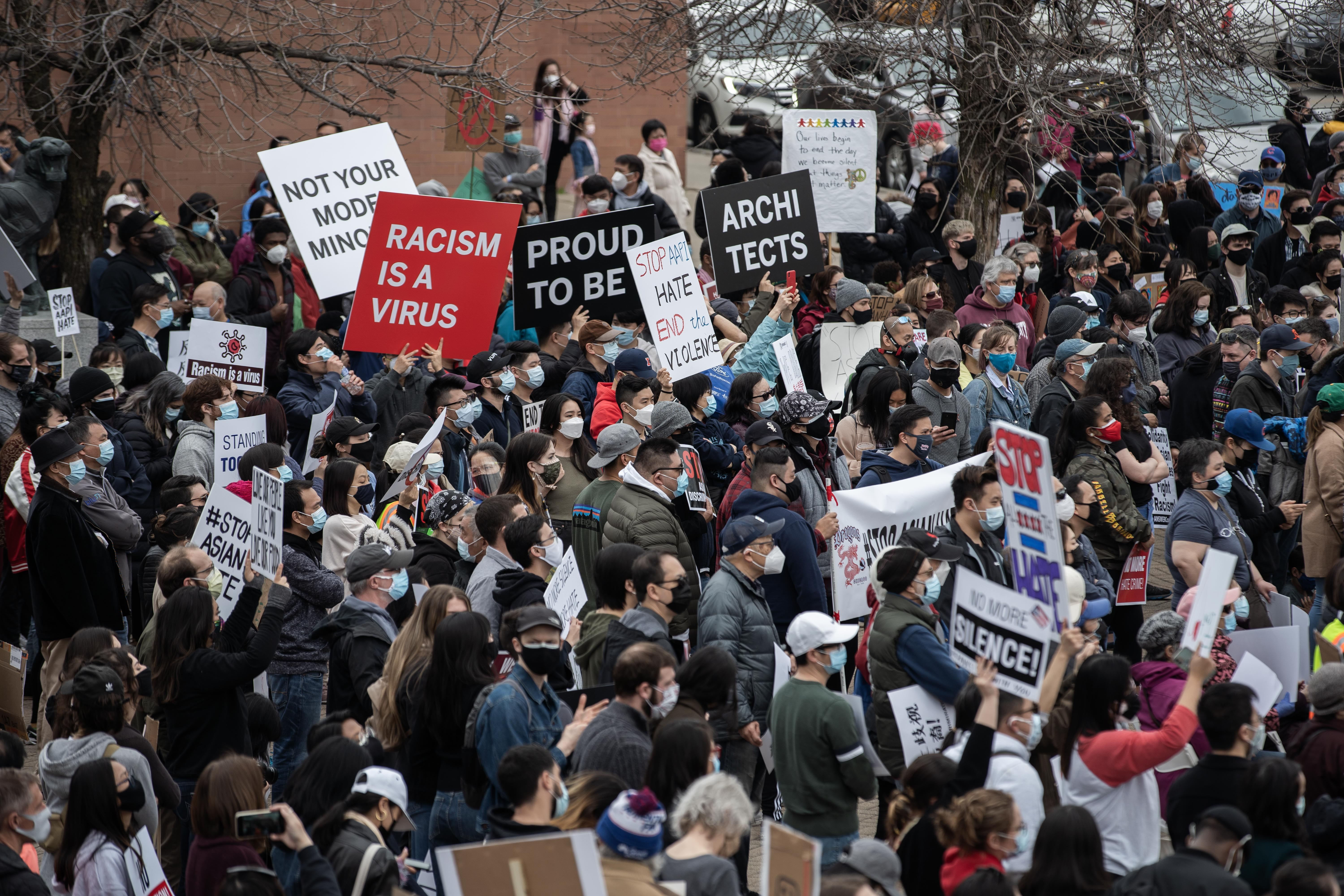 """Hundreds of people marched from Grant Park and attended a """"stop Asian hate"""" rally a rally in Chinatown to protest anti-Asian violence and harassment."""