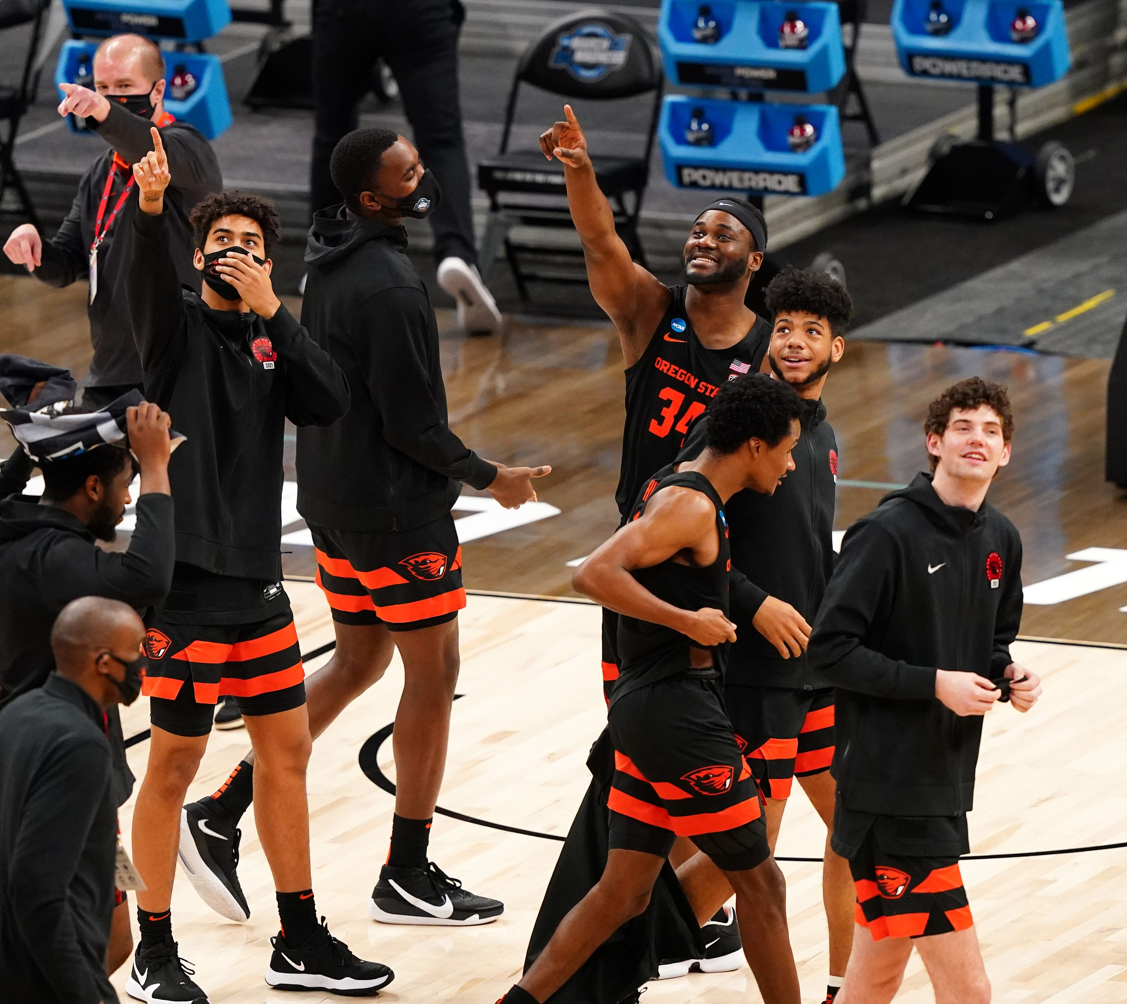 Oregon State Beavers players point to their fans after the win during the Sweet Sixteen round of the 2021 NCAA Tournament on Saturday, March 27, 2021, at Bankers Life Fieldhouse in Indianapolis, Ind.