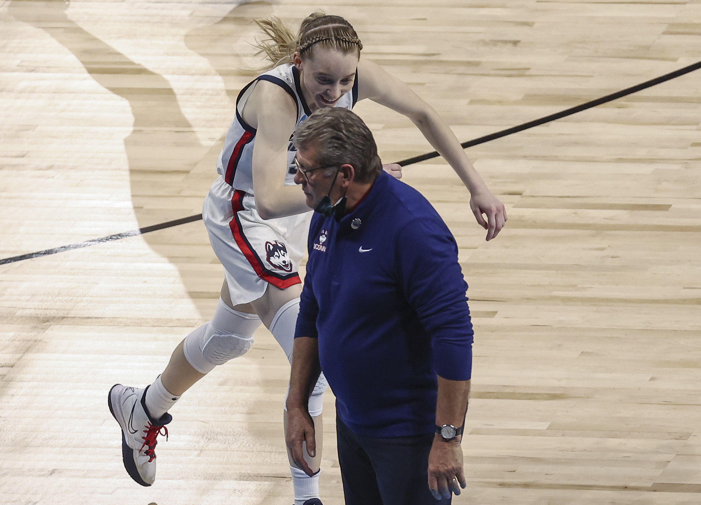 UConn Huskies guard Paige Bueckers (5) reacts with head coach Geno Auriemma during the fourth quarter against the Iowa Hawkeyes in the Sweet Sixteen of the 2021 Women's NCAA Tournament at Alamodome.