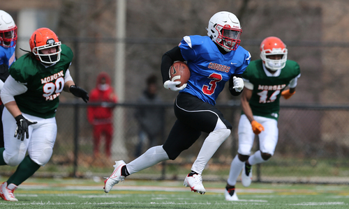 Curie's Turrant Johnson (3) runs up the middle for a big gain against Morgan Park.