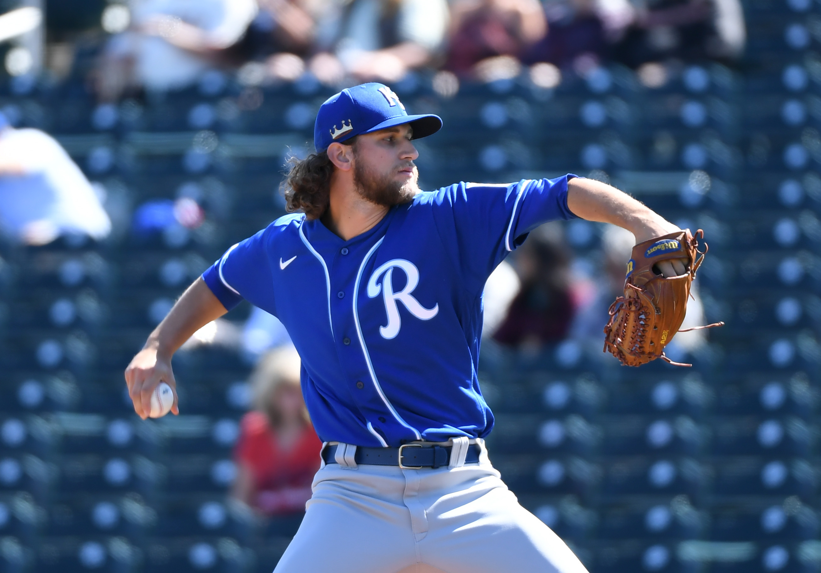 Jackson Kowar #37 of the Kansas City Royals delivers a pitch against the Cleveland Indians during a spring training game at Goodyear Ballpark on March 01, 2021 in Goodyear, Arizona.