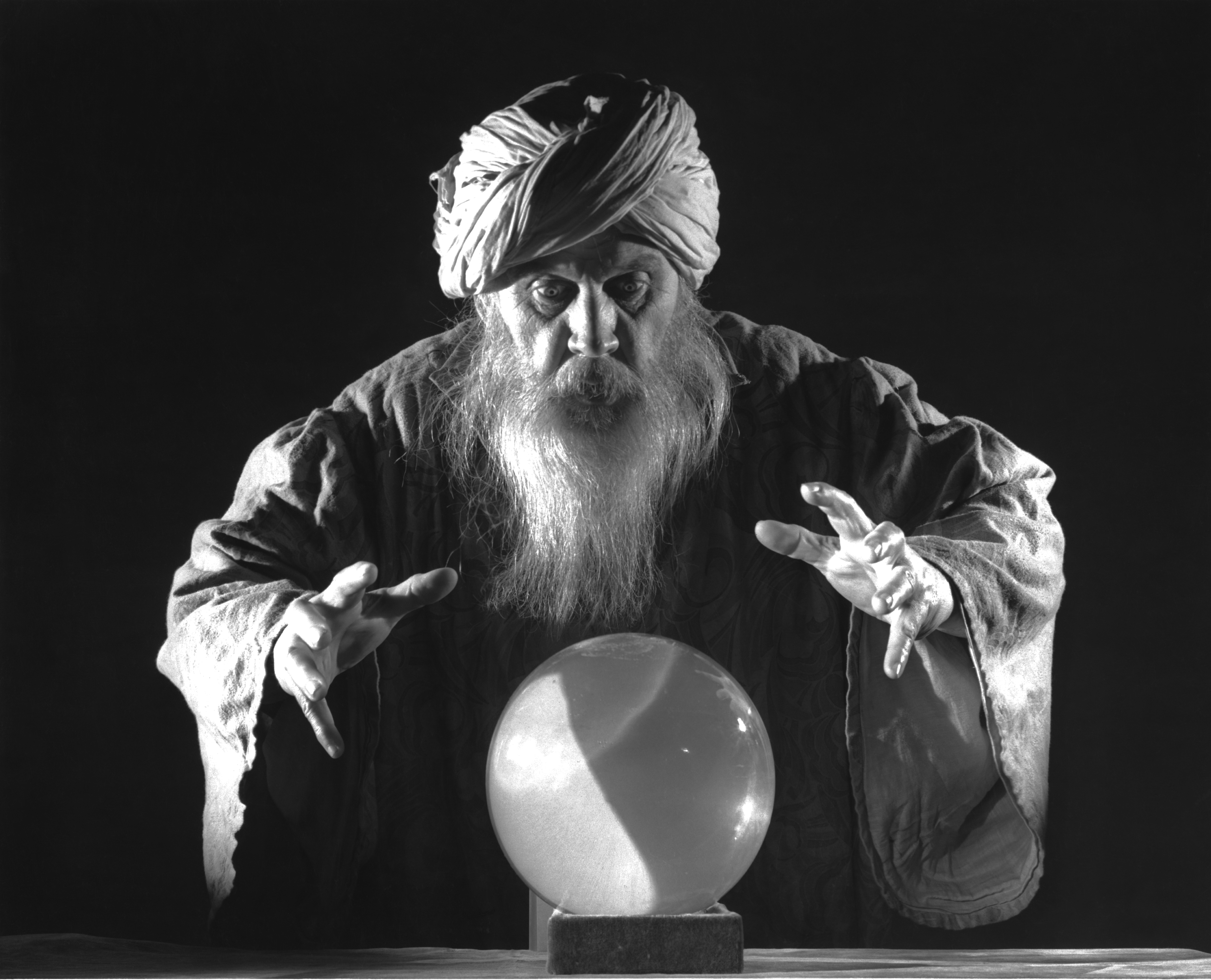 Wizard Man With Hands Out and Around Crystal Ball