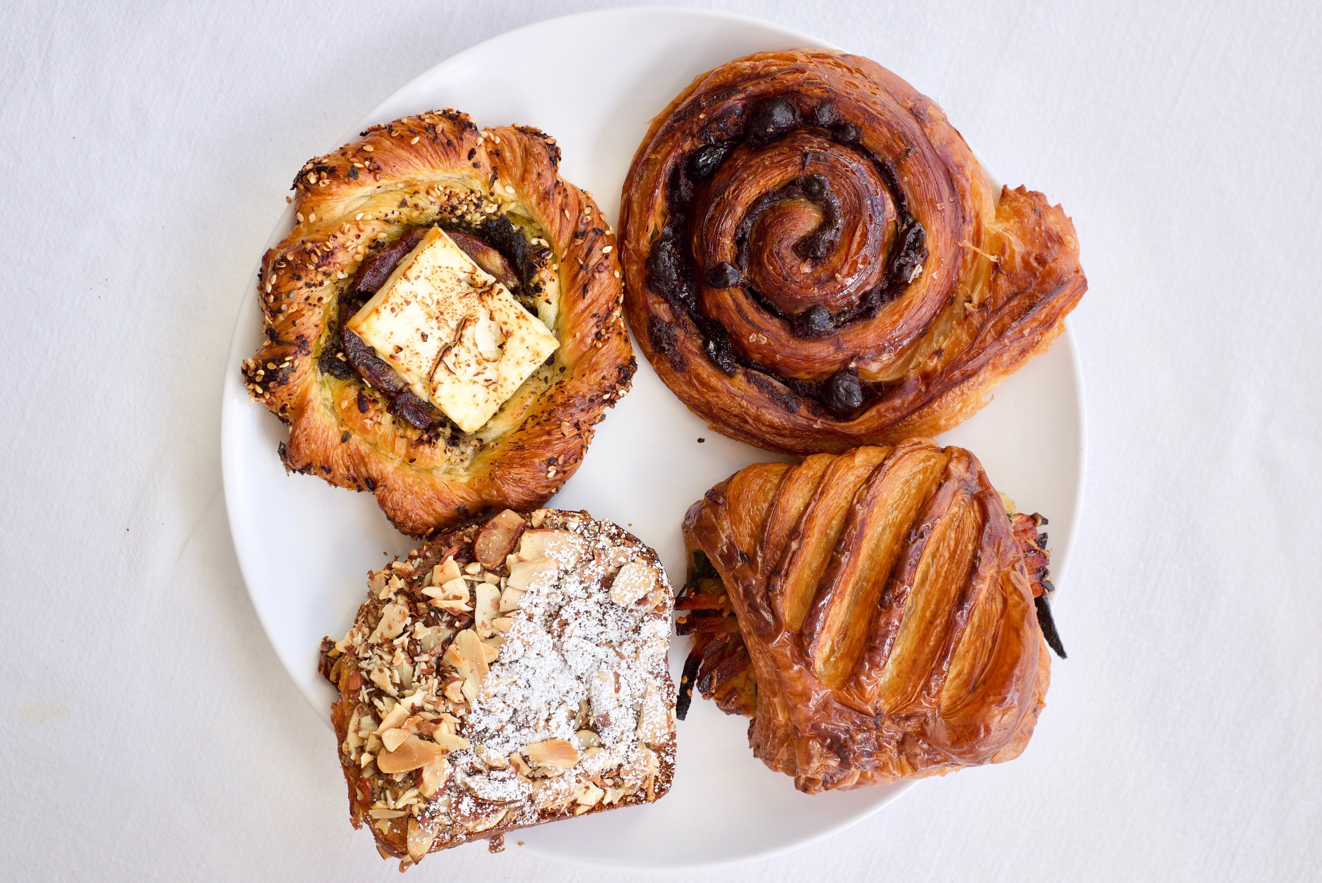 From above, a plate with four different pastries in various textures and shapes