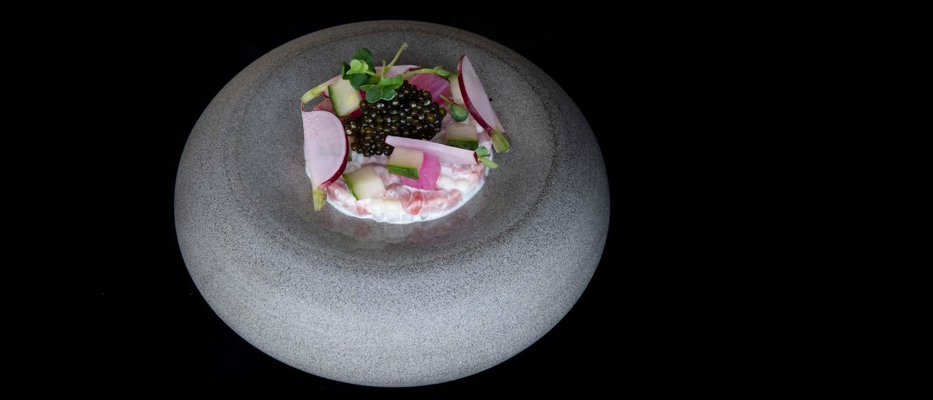 A salad on a stone dish