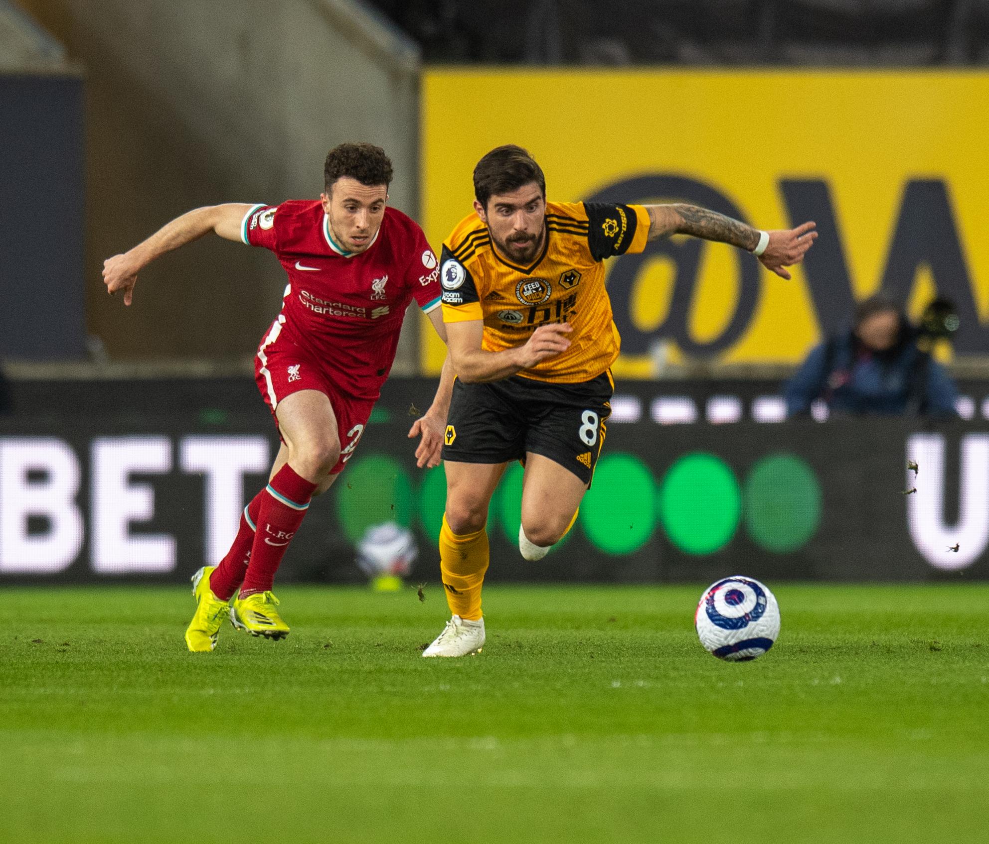 Diogo Jota vies for possession versus Ruben Neves - Wolverhampton Wanderers v Liverpool - Premier League