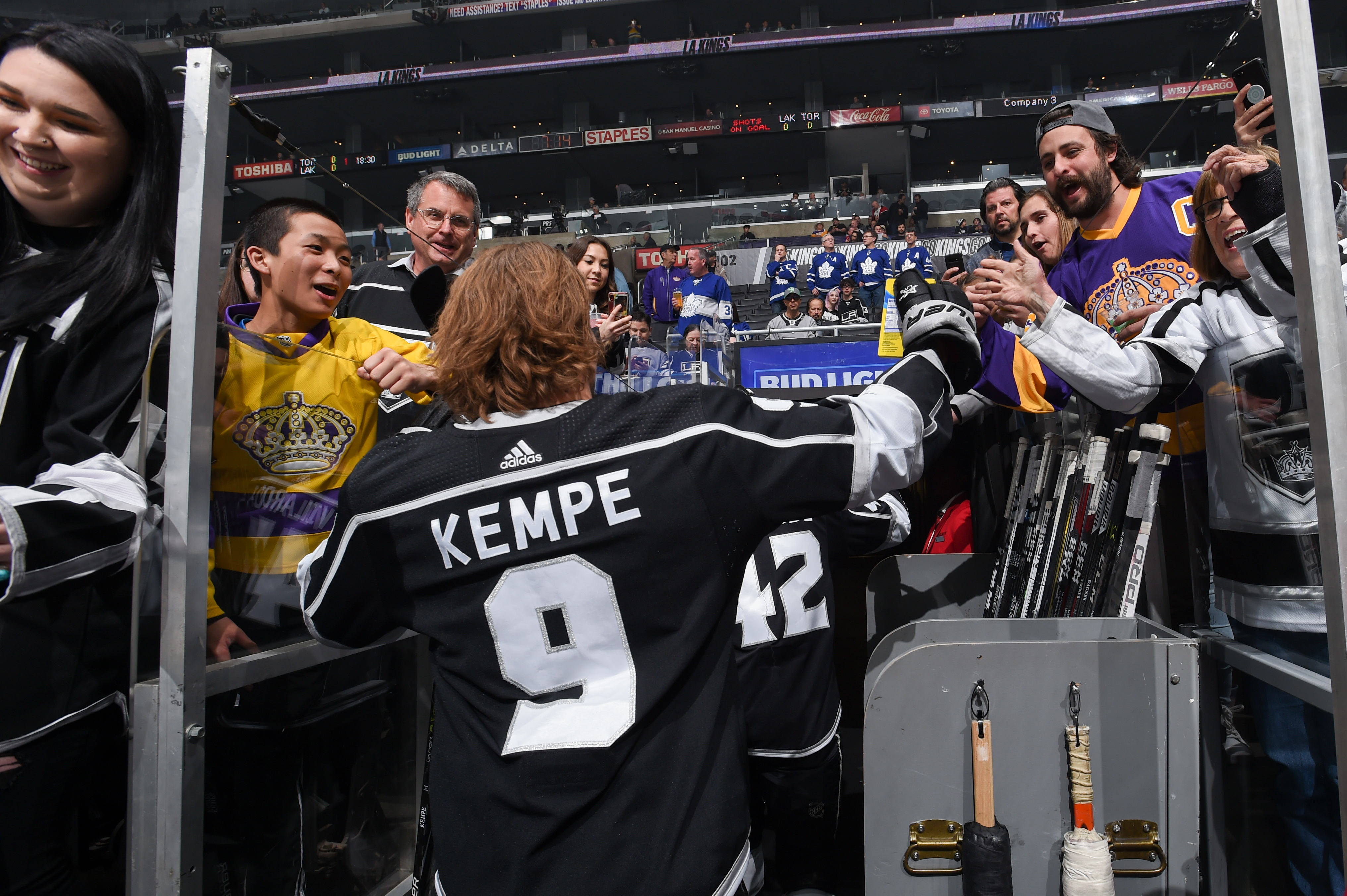 Adrian Kempe #9 of the Los Angeles Kings high fives fans during warm ups against the Toronto Maple Leafs at STAPLES Center on March 5, 2020 in Los Angeles, California.
