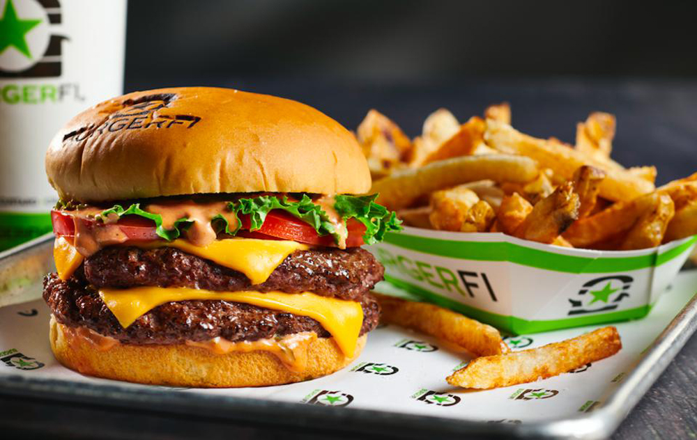 A Black Angus beef burger and fries, prepared with no antibiotics, or additives, and now available at BurgerFi in Henderson.
