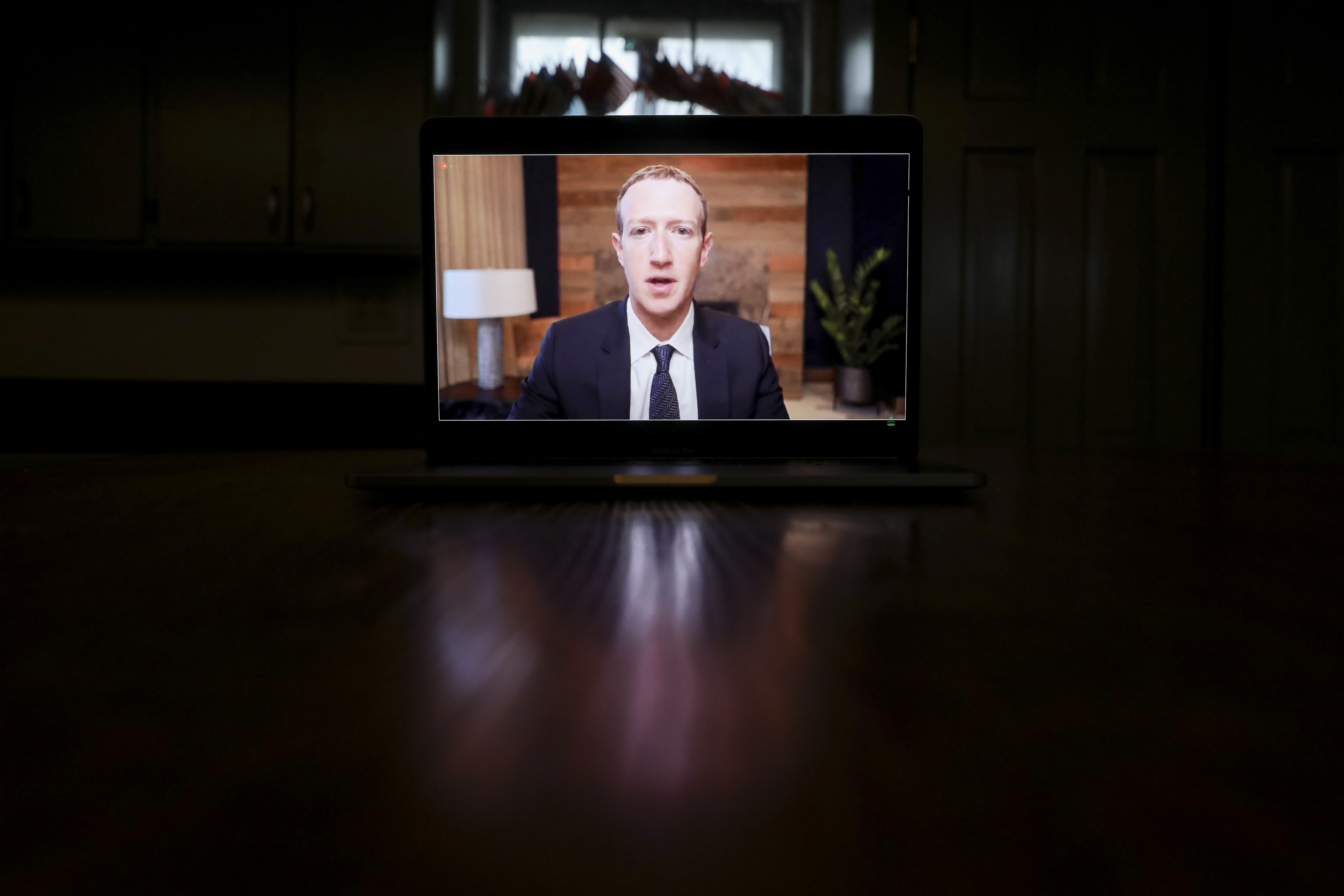 Mark Zuckerberg on a laptop screen.