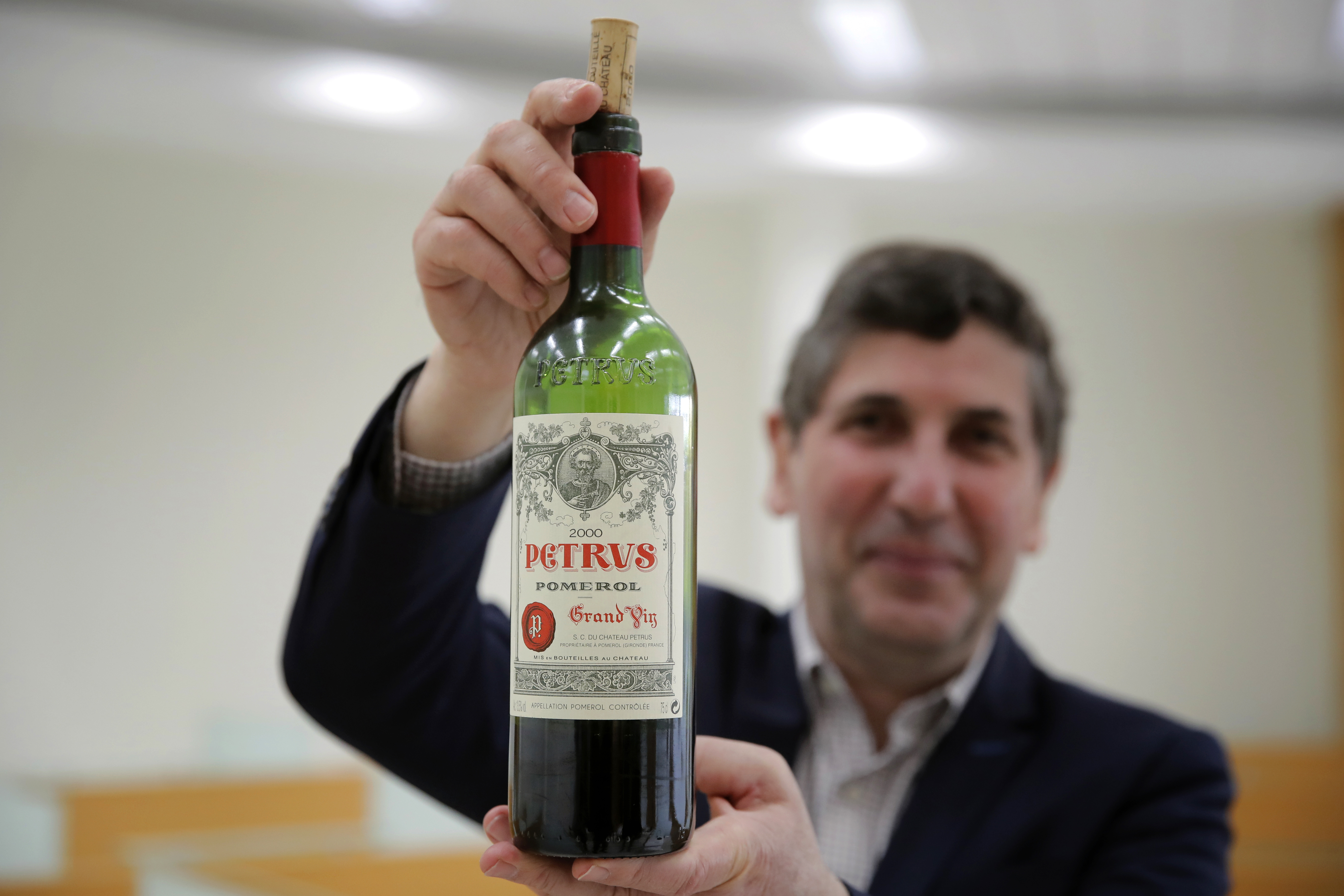Philippe Darriet, president of the Institute for Wine and Vine Research (ISVV) and chief oenologist holds a bottle of Petrus red wine that spent a year orbiting the world in the International Space Station after a tasting session at the ISVV in Villenave-d'Ornon, southwestern France on March 1, 2021.