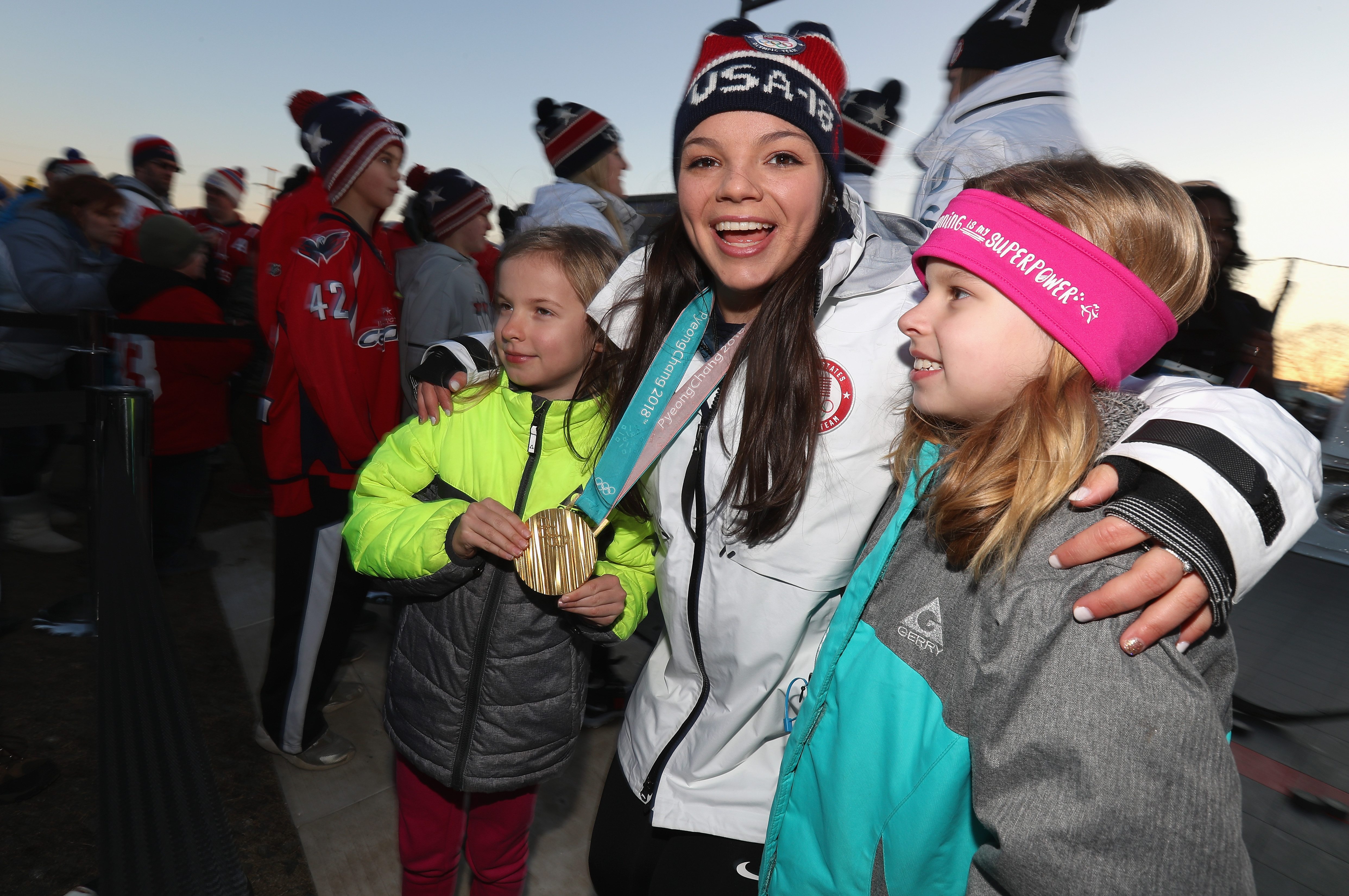 Cayla Barnes of the United States Women's Ice Hockey Team poses with hockey fans during the 2018 Coors Light NHL Stadium Series game between the Toronto Maple Leafs and the Washington Capitals at the Navy-Marine Corps Memorial Stadium on March 3, 2018 in Annapolis, Maryland.