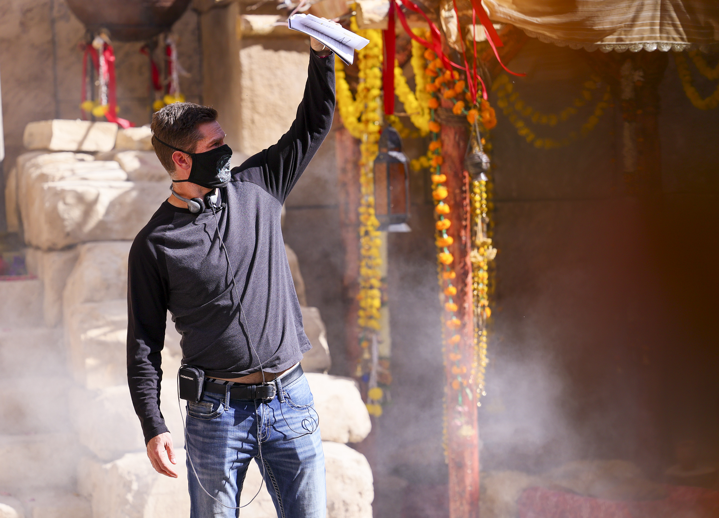 """Director Dallas Jenkins shields his eyes from the light during filming of a faith-based streaming series on the life of Jesus Christ called """"The Chosen"""" at The Church of Jesus Christ of Latter-day Saints' Jerusalem set in Goshen, Utah County, on Monday, Oct. 19, 2020."""