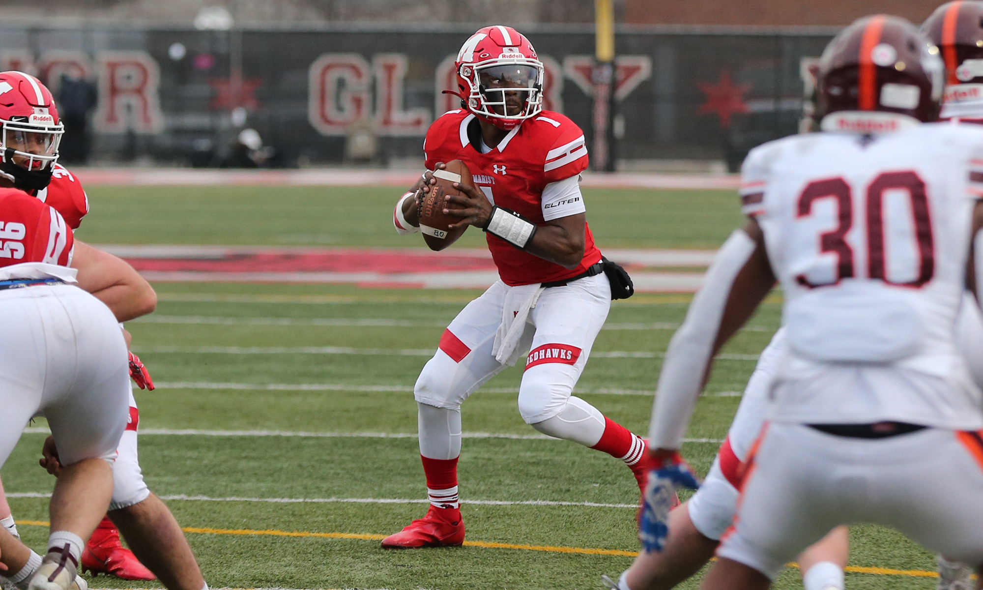 Marist's Dontrell Jackson, Jr., (1) drops back to pass the ball against Brother Rice.