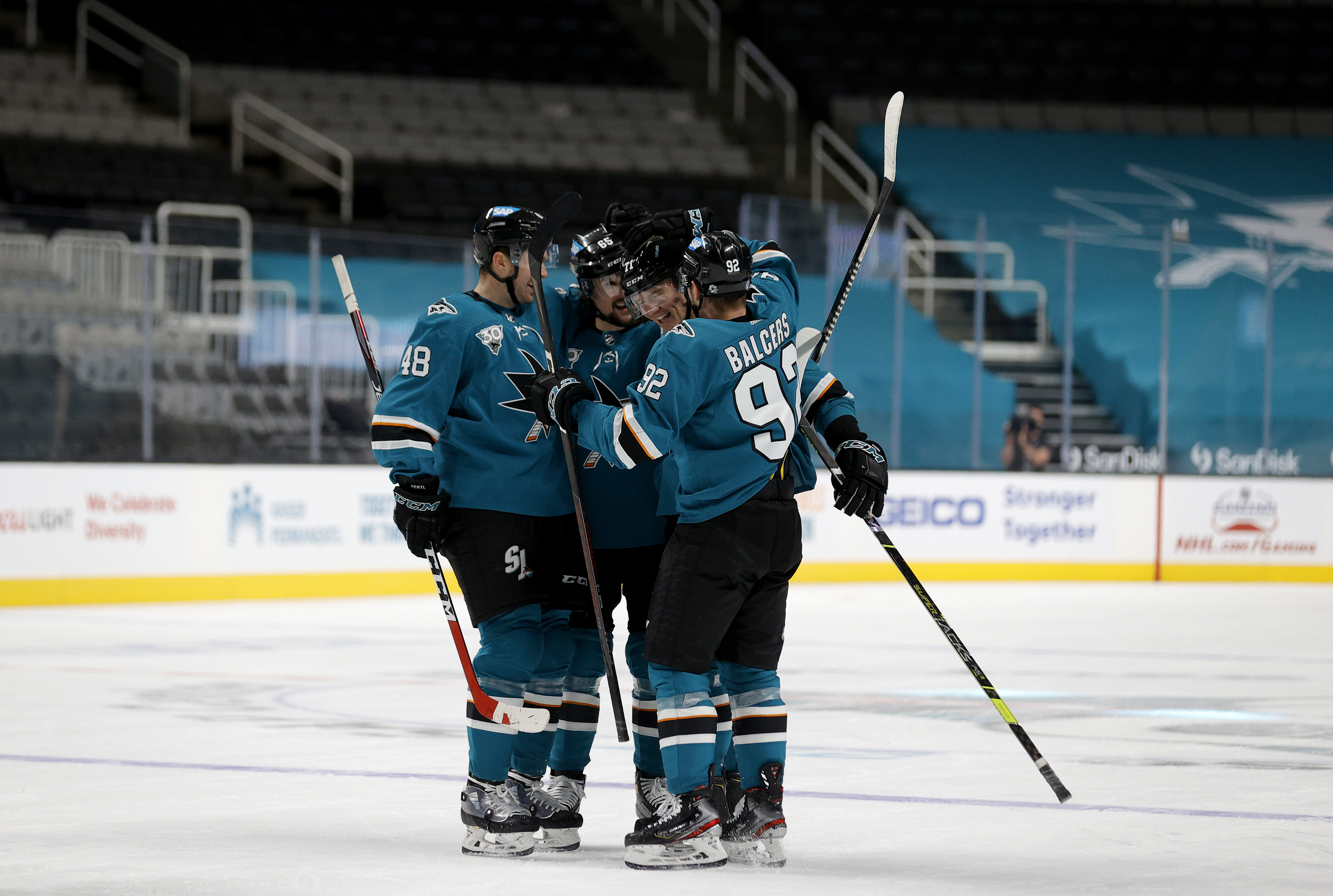 Nikolai Knyzhov #71 of the San Jose Sharks is congratulated by teammates after he scored a goal against the Minnesota Wild in the third period at SAP Center on March 31, 2021 in San Jose, California.