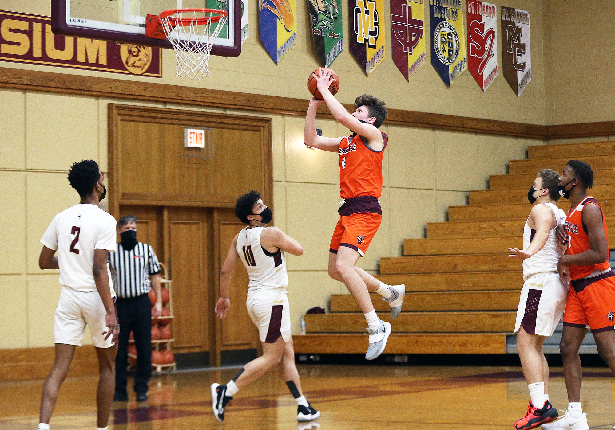 Brother Rice's Frank Cunnea (4) floats in the lane and hits a short jumper against St. Ignatius.