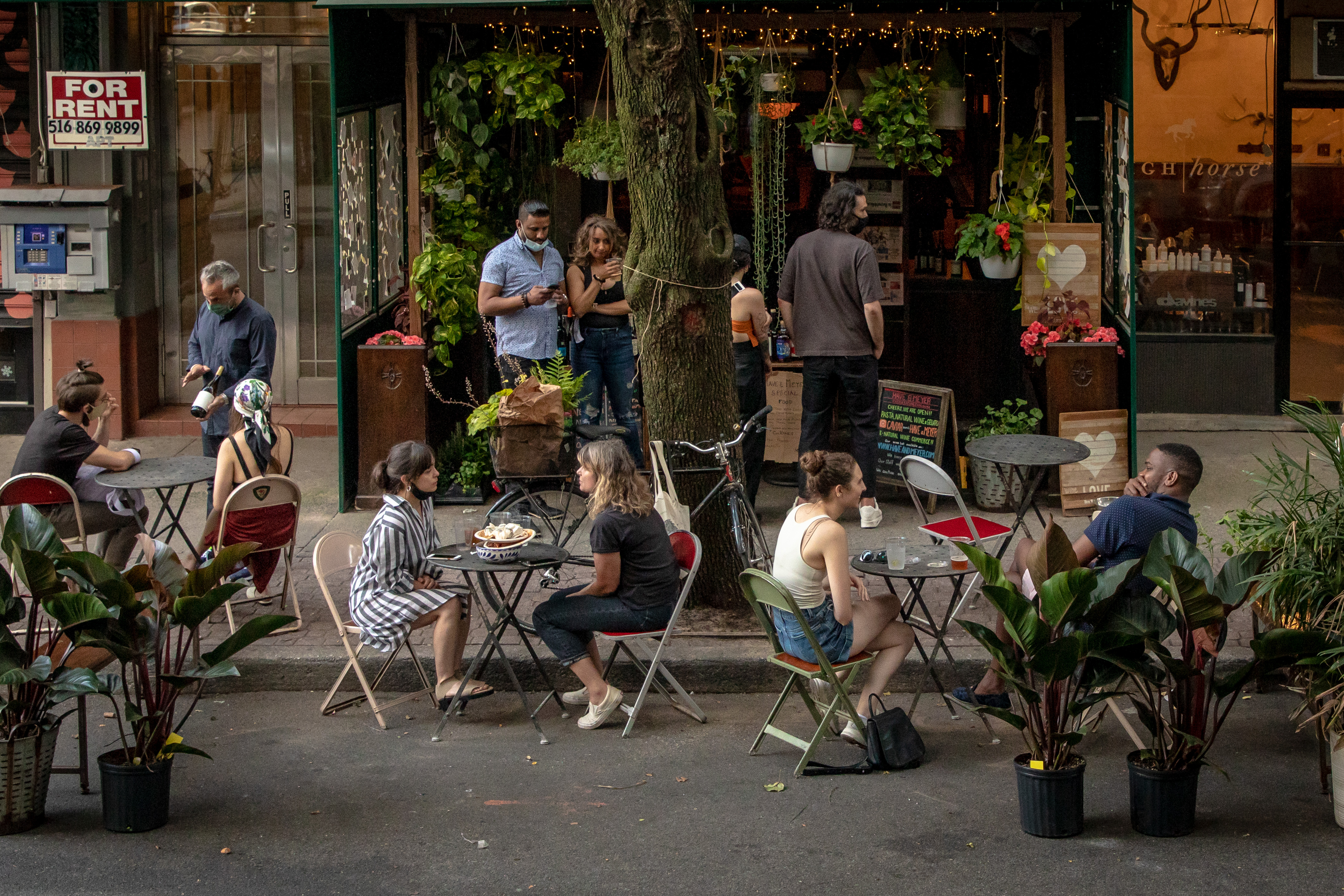 Customers dine at outdoor tables at Have & Meyer