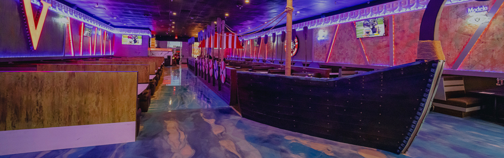 The main dining room featuring a Viking ship seating area at new Henderson restaurant, The Vikings Boiling Seafood.