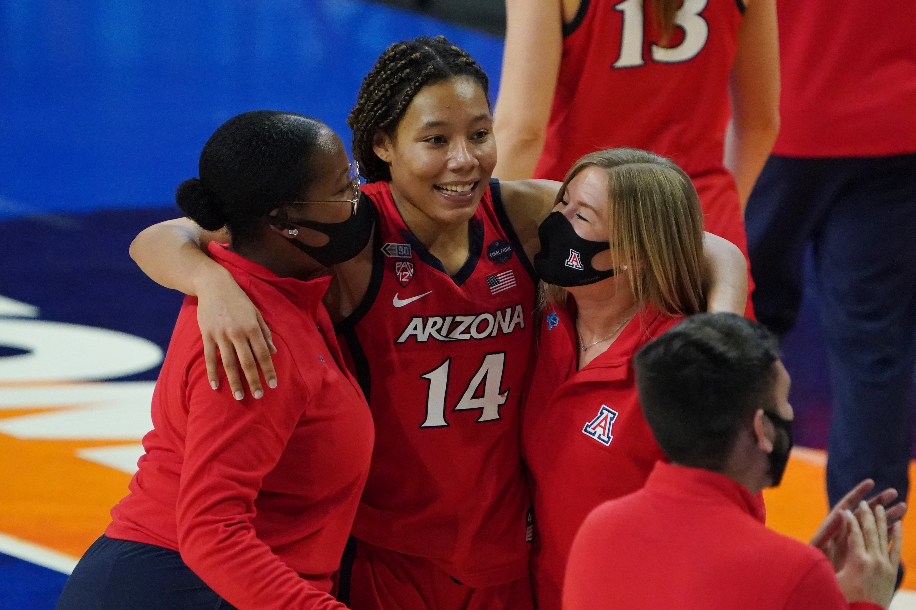 Arizona Wildcats forward Sam Thomas celebrates after defeating the UConn Huskies in the national semifinals of the women's Final Four of the 2021 NCAA Tournament at Alamodome.