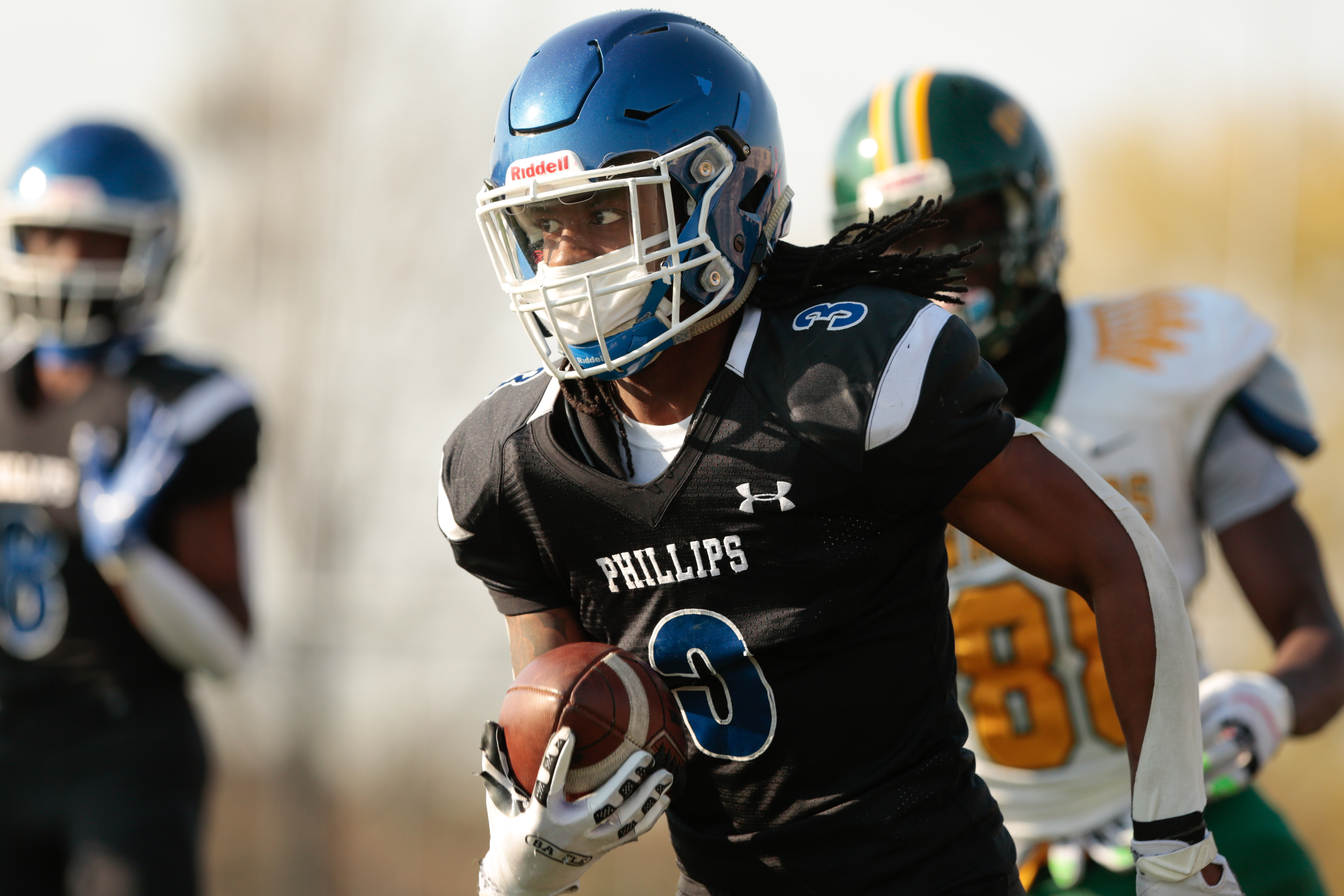Phillips' Jacoby Erving (3) runs for a touchdown against Westinghouse.