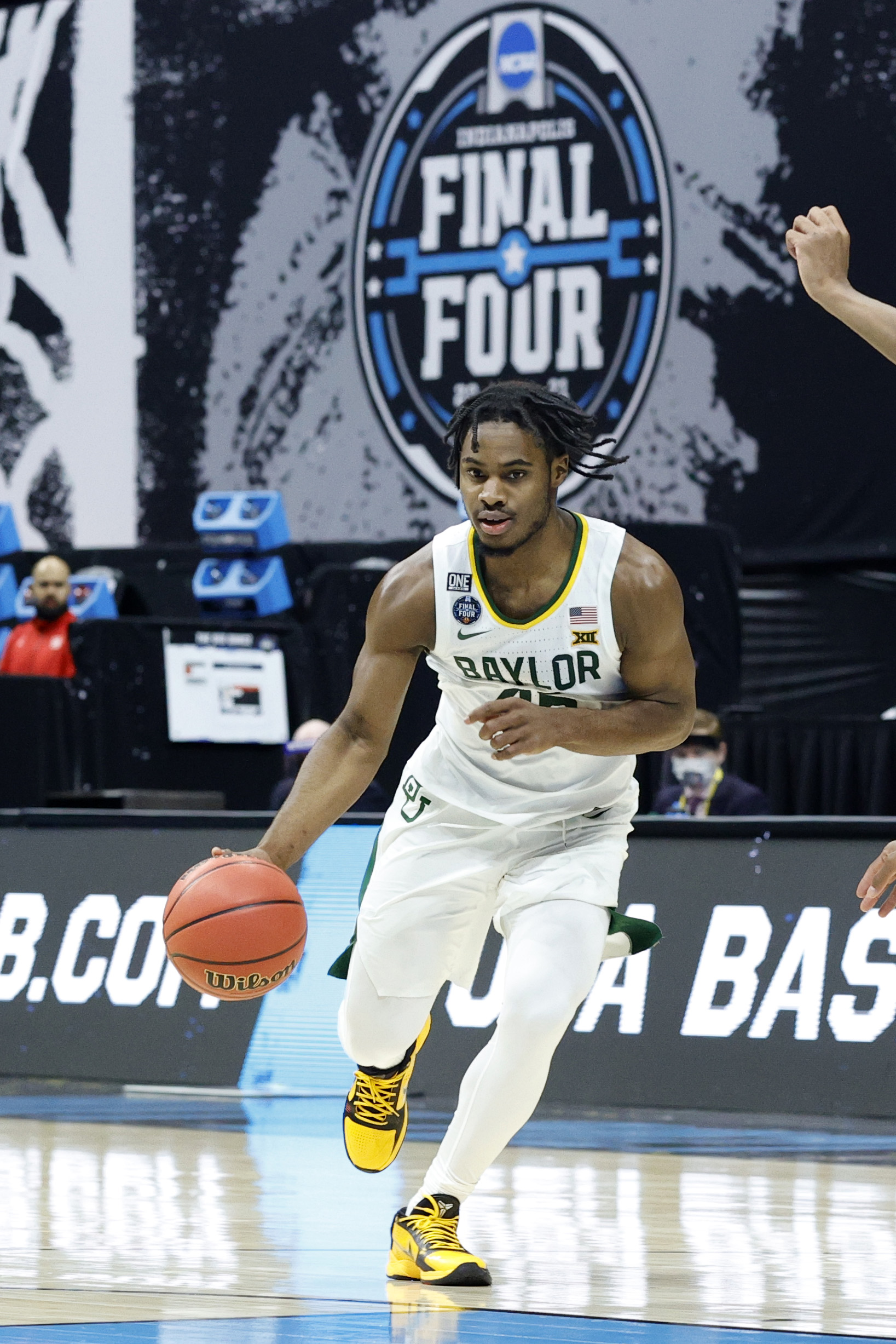 Davion Mitchell #45 of the Baylor Bears dribbles in the second half against the Houston Cougars during the 2021 NCAA Final Four semifinal at Lucas Oil Stadium on April 03, 2021 in Indianapolis, Indiana.