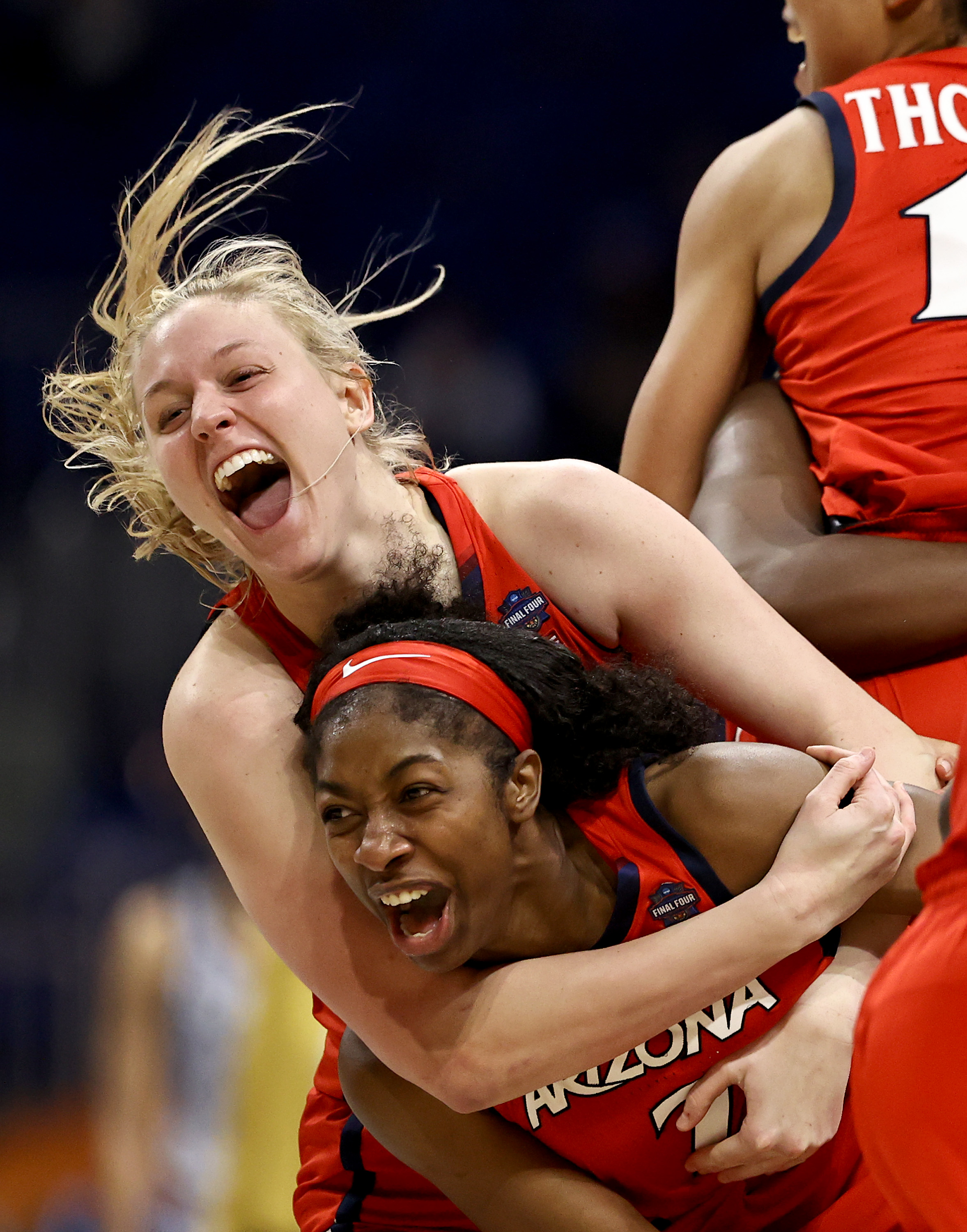 Aari McDonald and Cate Reese of the Arizona Wildcats celebrate with teammates after defeating the UConn Huskies during the third quarter in the Final Four semifinal game of the 2021 NCAA Women's Basketball Tournament at the Alamodome on April 02, 2021 in San Antonio, Texas.