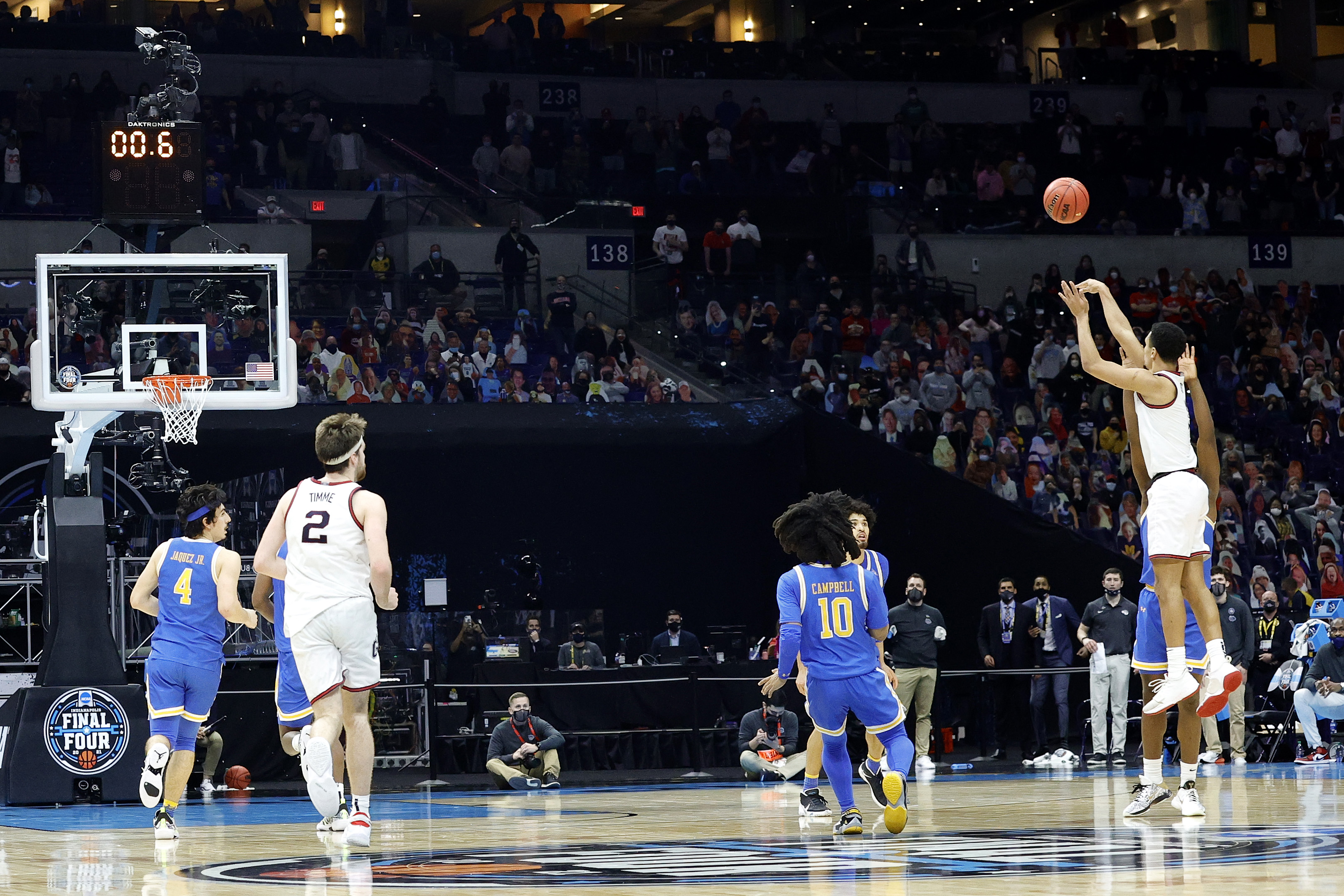Jalen Suggs of the Gonzaga Bulldogs shoots a game-winning three point basket in overtime to defeat the UCLA Bruins 93-90 during the 2021 NCAA Final Four semifinal at Lucas Oil Stadium on April 03, 2021 in Indianapolis, Indiana.