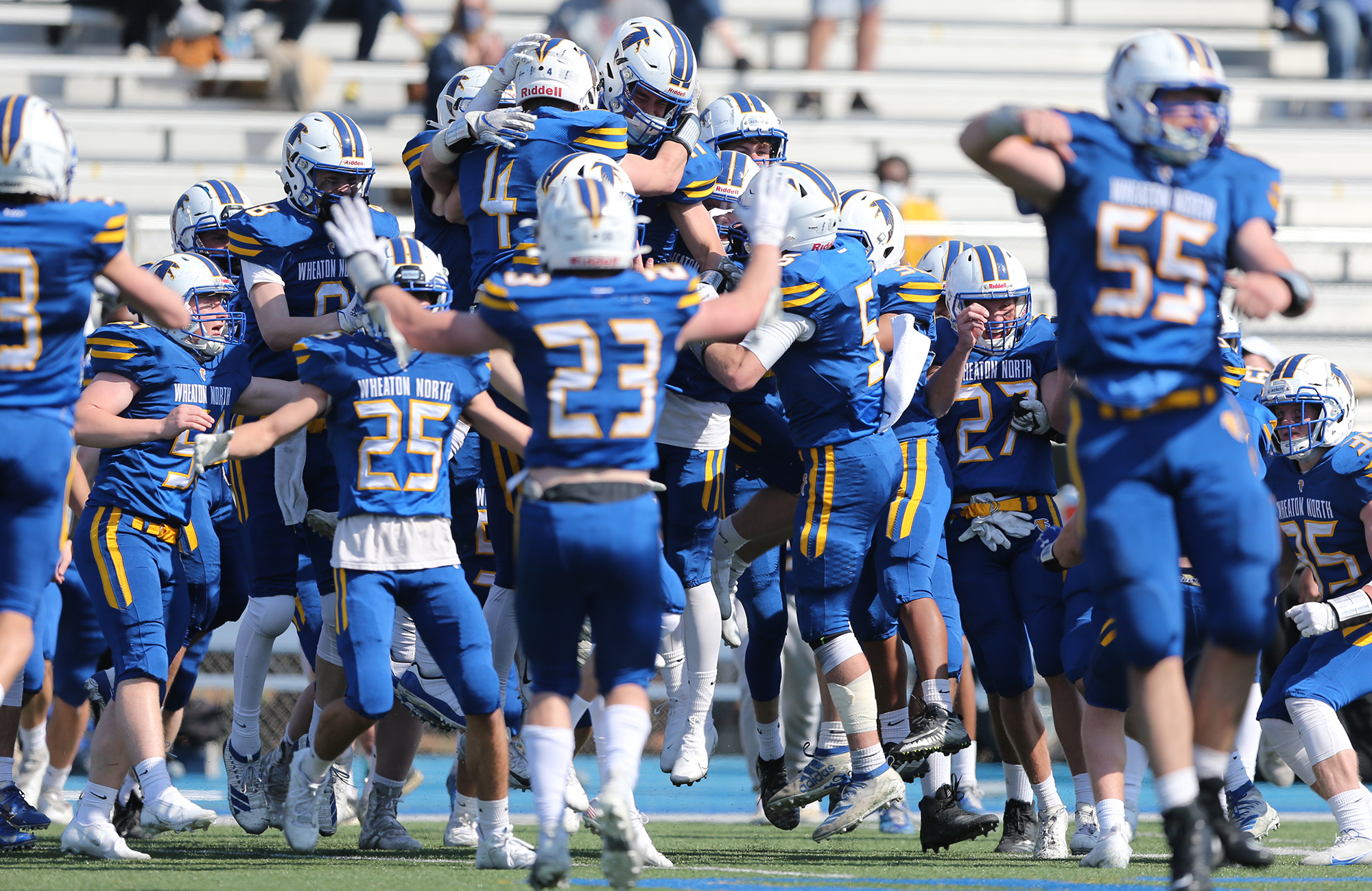 Wheaton North players celebrate their 17-14 victory over Wheaton Warrenville South.