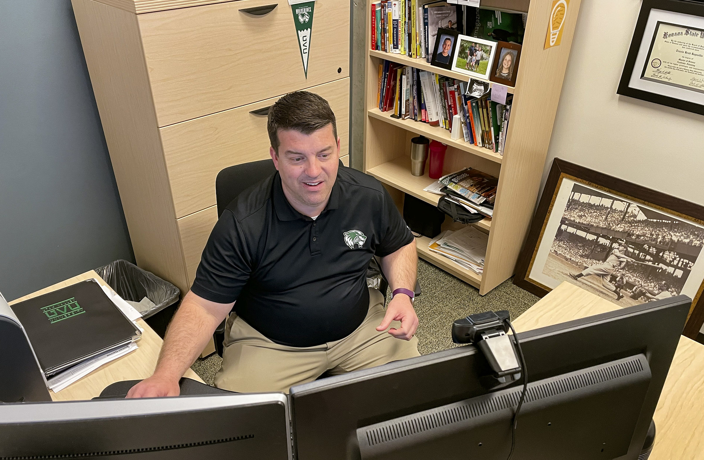 UVUU career counselor Travis Reynolds helps a student with her LinkedIn profile and portfolio during a virtual call in his office in the Career Development Center on the UVUU campus April 2, 2021.