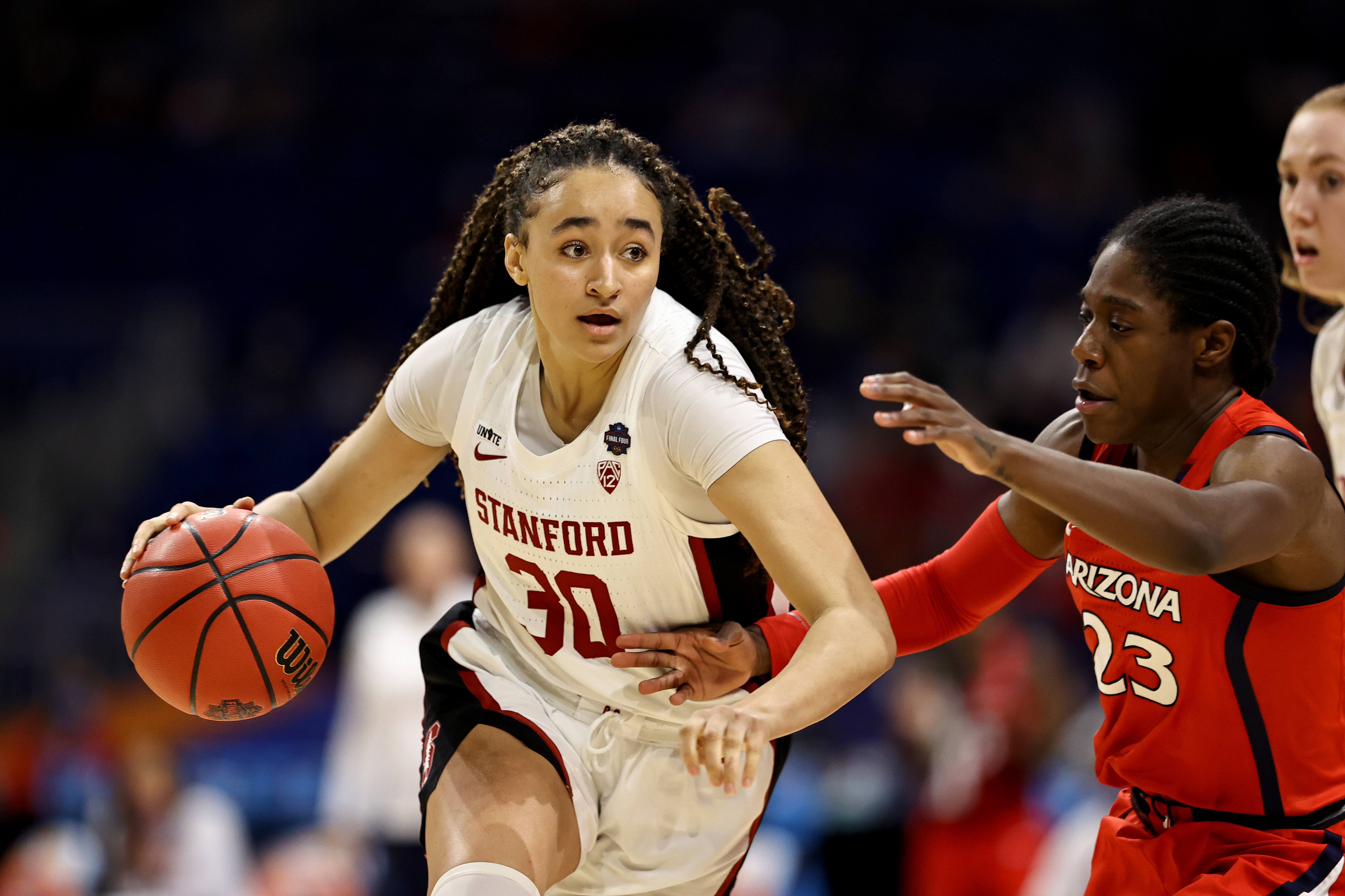 Haley Jones #30 of the Stanford Cardinals brings the ball up the court against Bendu Yeaney #23 of the Arizona Wildcats in the National Championship game of the 2021 NCAA Women's Basketball Tournament at the Alamodome on April 04, 2021 in San Antonio, Texas.