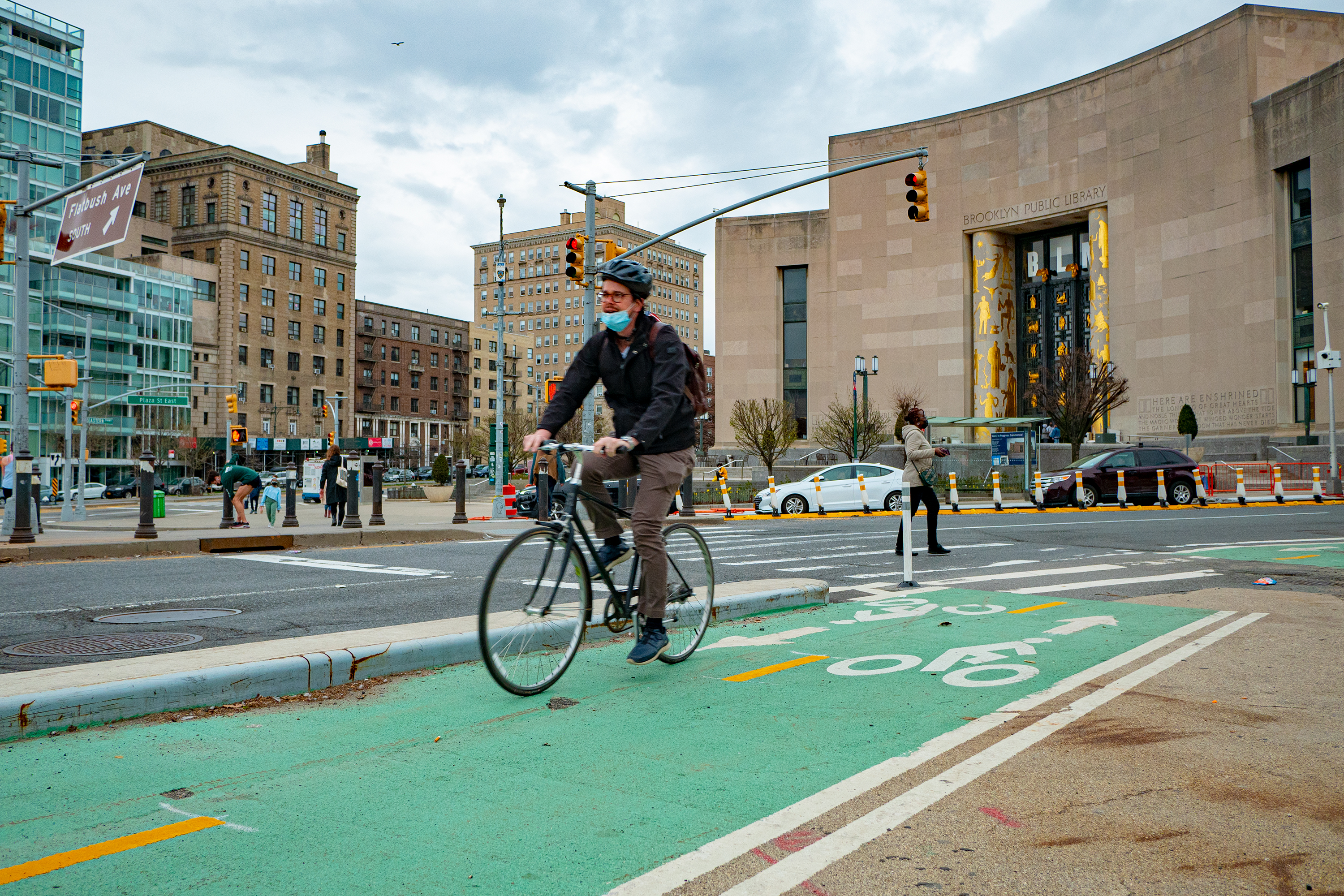 A cyclist uses the greenway at Grand Army Plaza, in Brooklyn, March 31, 2021.