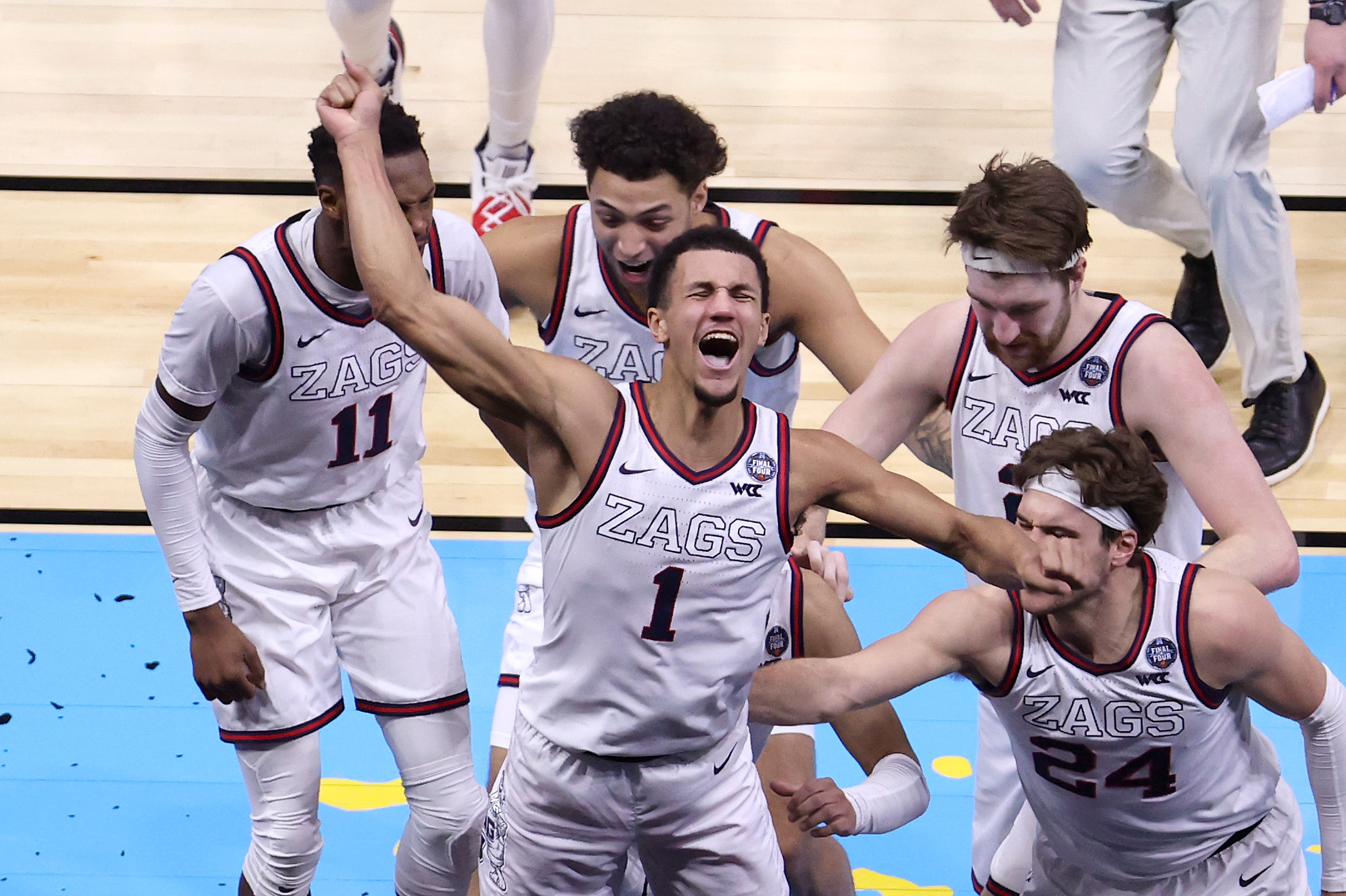 Jalen Suggs of the Gonzaga Bulldogs celebrates with teammates after making a game-winning three point basket in overtime to defeat the UCLA Bruins 93-90 during the 2021 NCAA Final Four semifinal at Lucas Oil Stadium on April 03, 2021 in Indianapolis, Indiana.