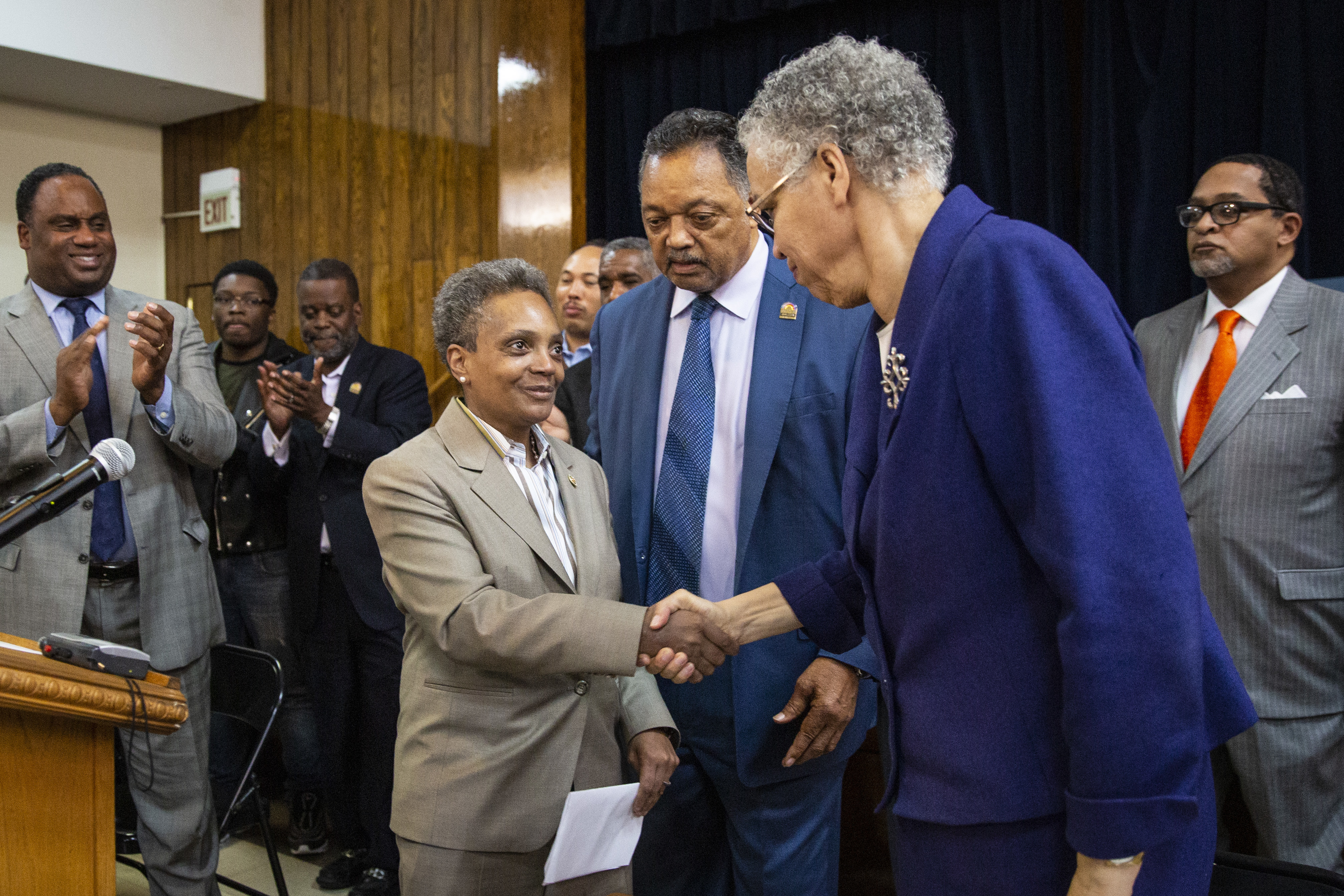 Mayor-elect Lori Lightfoot (left) shakes hands with former mayoral candidate Cook County Board President Toni Preckwinkle as Rev. Jesse Jackson looks on during a press conference at Rainbow PUSH on the Wednesday morning after Lightfoot's victory.