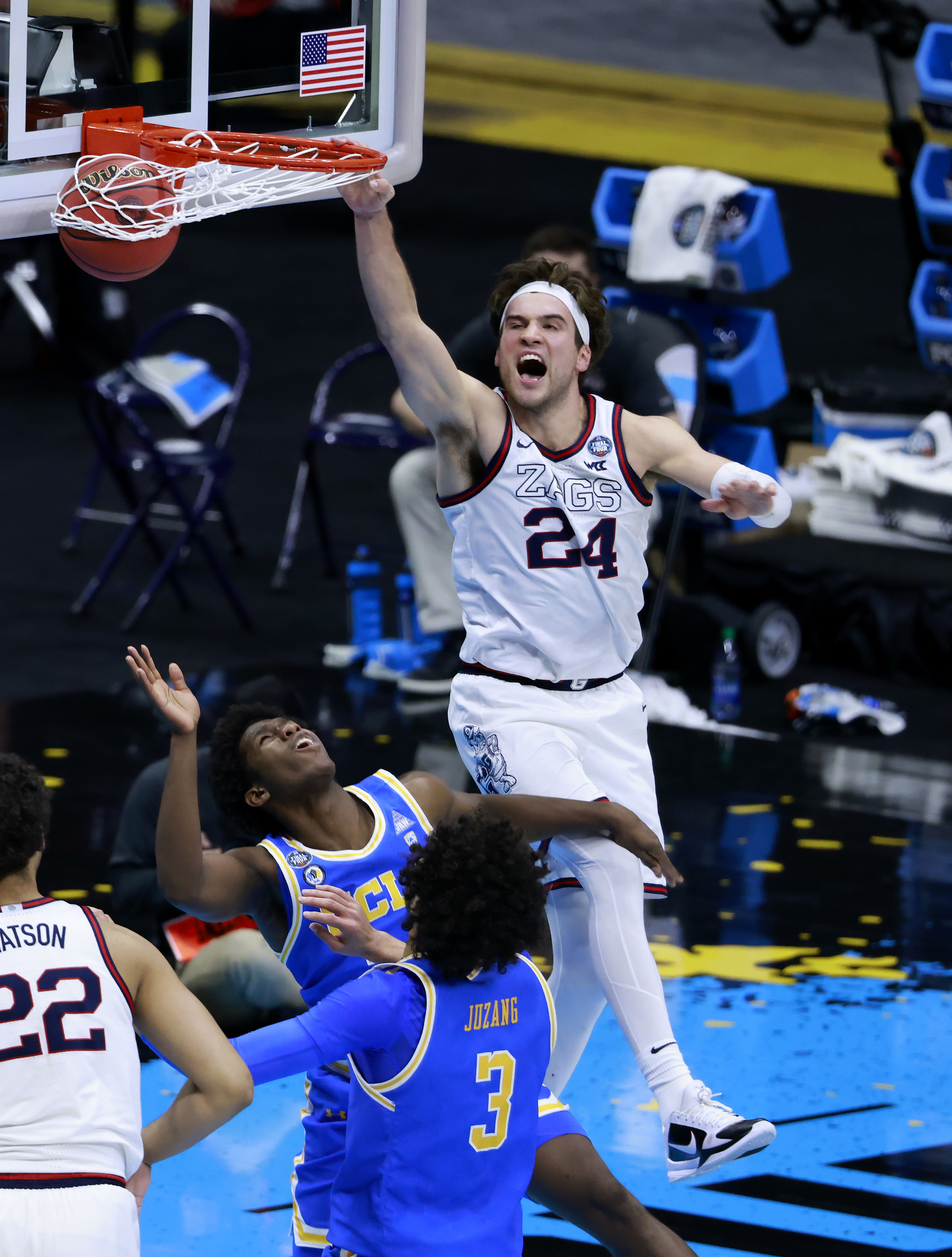 Corey Kispert of the Gonzaga Bulldogs dunks the ball against David Singleton #34 of the UCLA Bruins in the second half during the 2021 NCAA Final Four semifinal at Lucas Oil Stadium on April 03, 2021 in Indianapolis, Indiana.