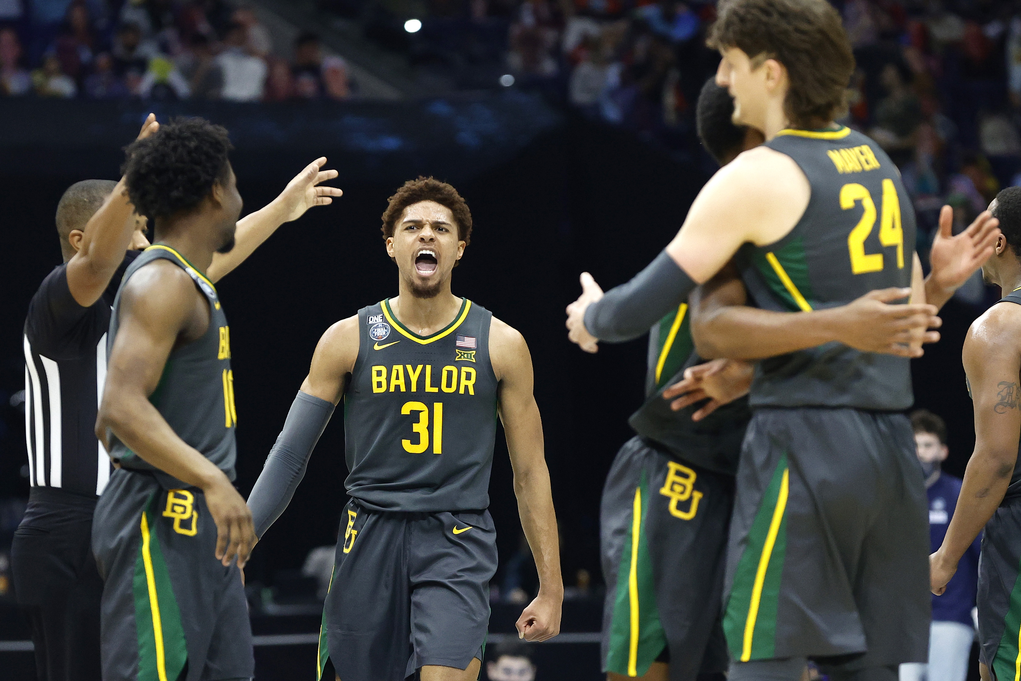 MaCio Teague of the Baylor Bears reacts in the second half of the National Championship game of the 2021 NCAA Men's Basketball Tournament against the Gonzaga Bulldogs at Lucas Oil Stadium on April 05, 2021 in Indianapolis, Indiana.