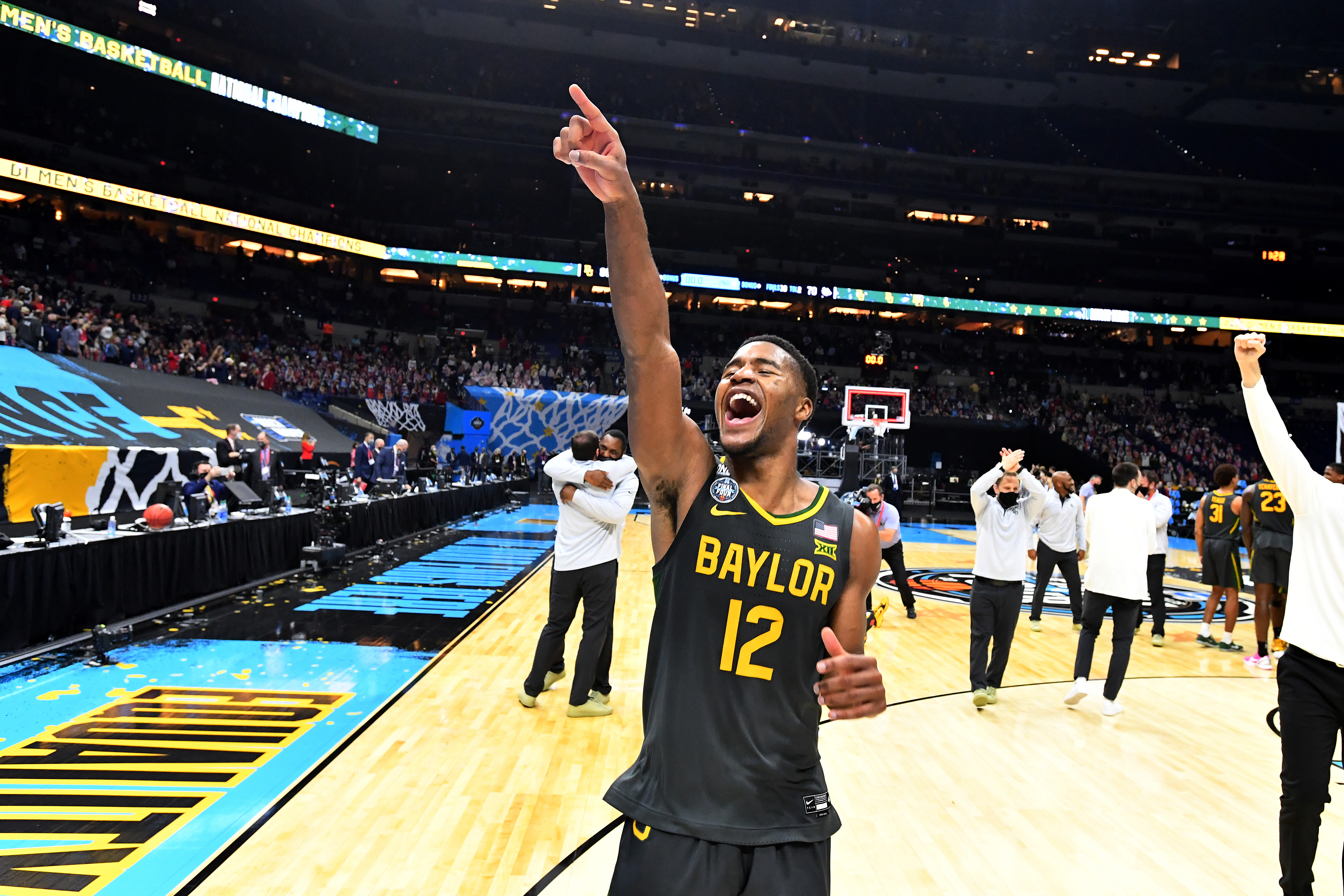Jared Butler #12 of the Baylor Bears celebrates after defeating the Gonzaga Bulldogs in the National Championship game of the 2021 NCAA Men's Basketball Tournament at Lucas Oil Stadium on April 05, 2021 in Indianapolis, Indiana.