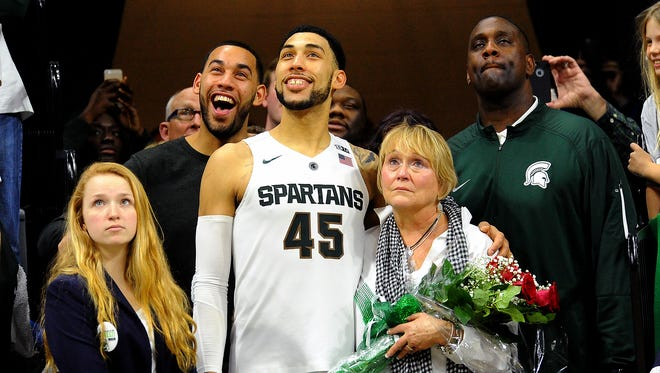 Drew and Denzel Valentine share a moment with their family at Michigan State's Senior Day in 2016.