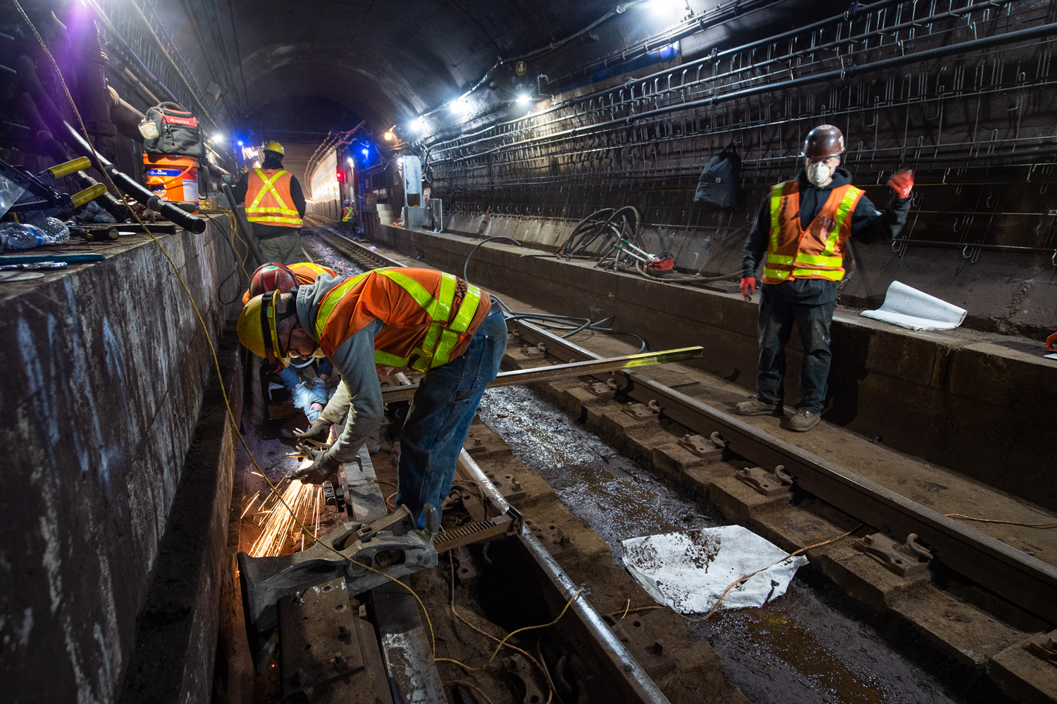 MTA workers in the F Line's East River Tunnel on March 21, 2021.