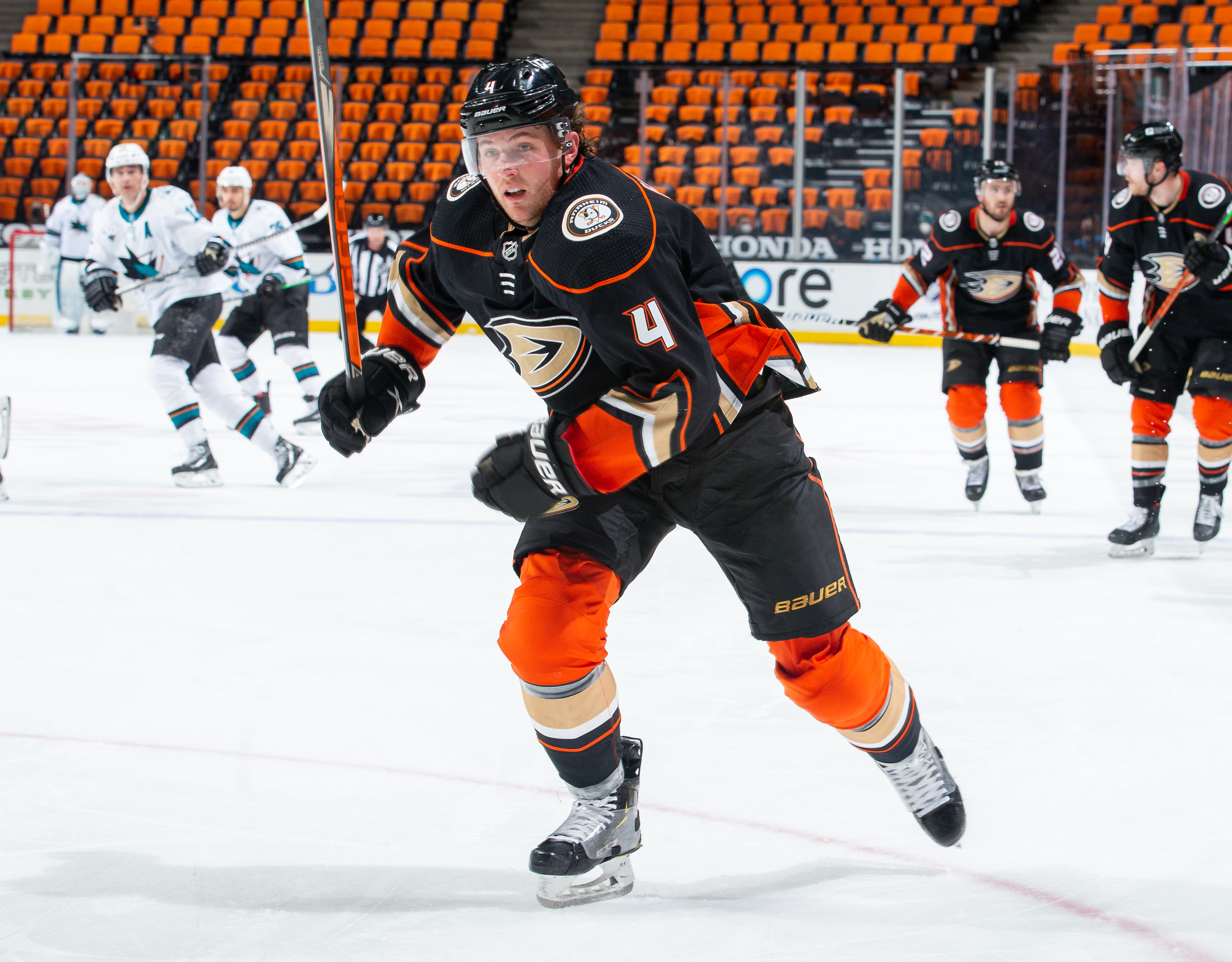 Cam Fowler #4 of the Anaheim Ducks races for the puck during the third period of the game against the San Jose Sharks at Honda Center on March 13, 2021 in Anaheim, California.