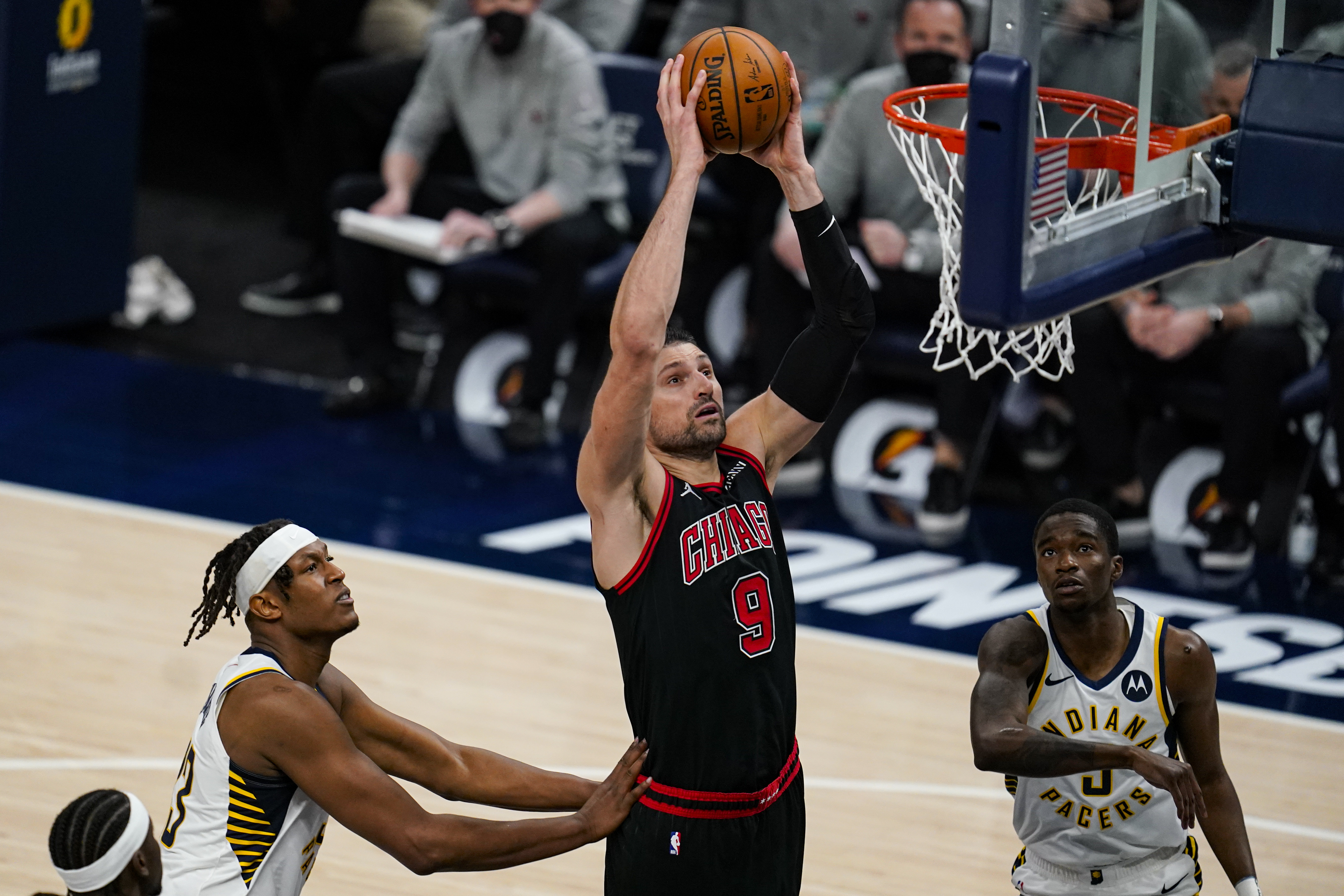 Bulls center Nikola Vucevic dunks over Pacers guard Edmond Sumner during the second half of Tuesday night's game.
