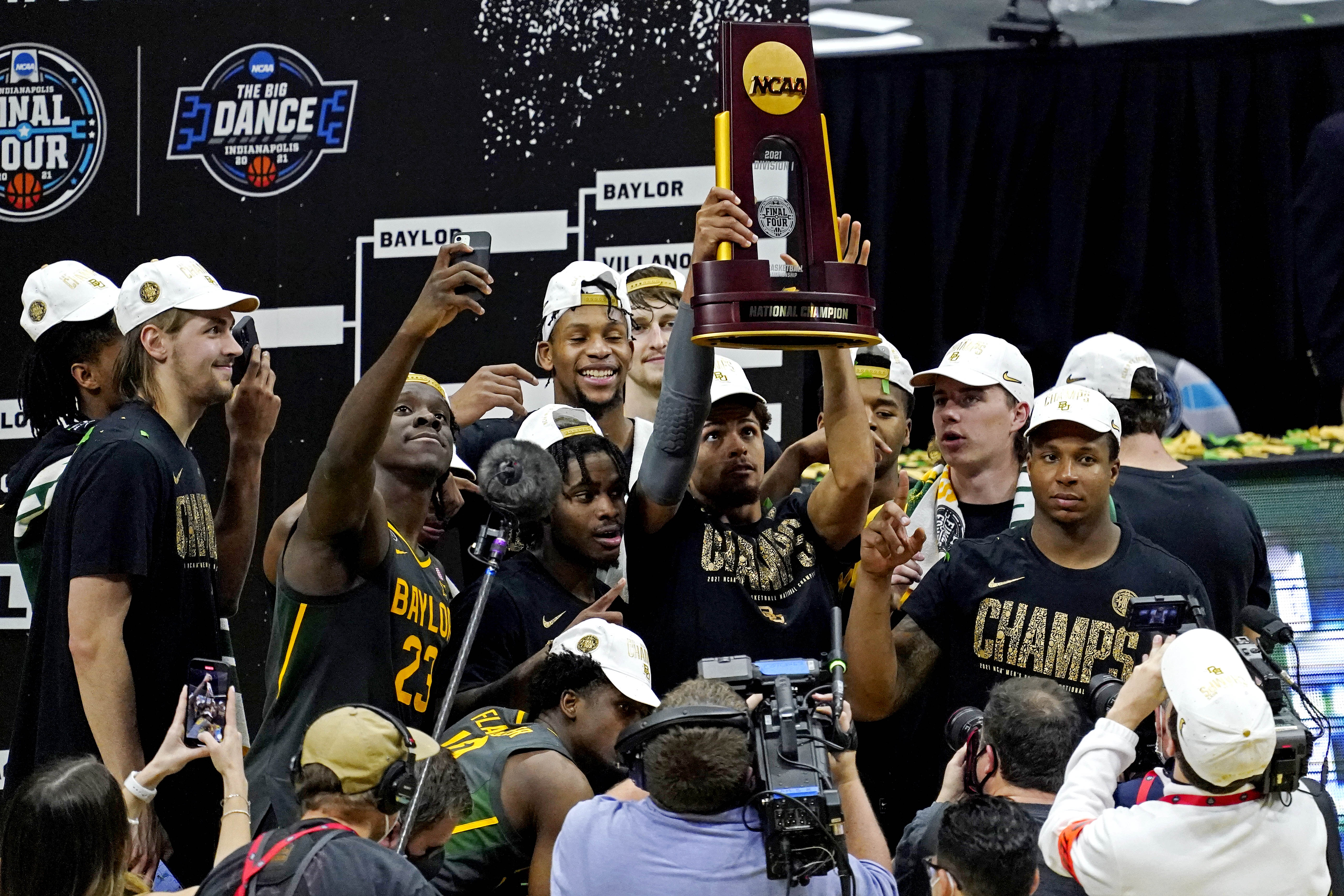 The Baylor Bears celebrate after beating the Gonzaga Bulldogs in the national championship game during the Final Four of the 2021 NCAA Tournament at Lucas Oil Stadium.