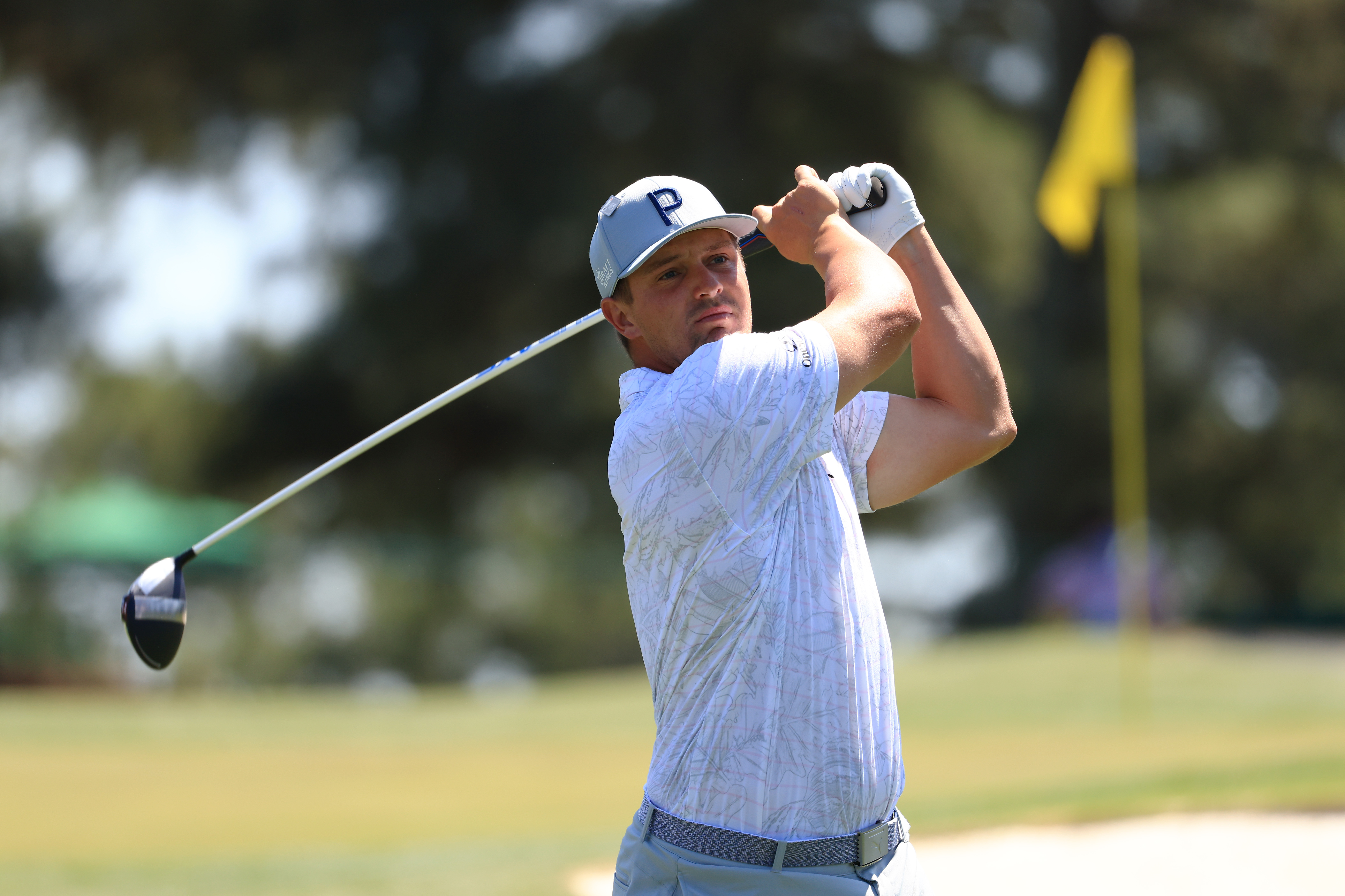 Bryson DeChambeau of the United States plays his shot from the third tee during a practice round prior to the Masters at Augusta National Golf Club on April 05, 2021 in Augusta, Georgia.