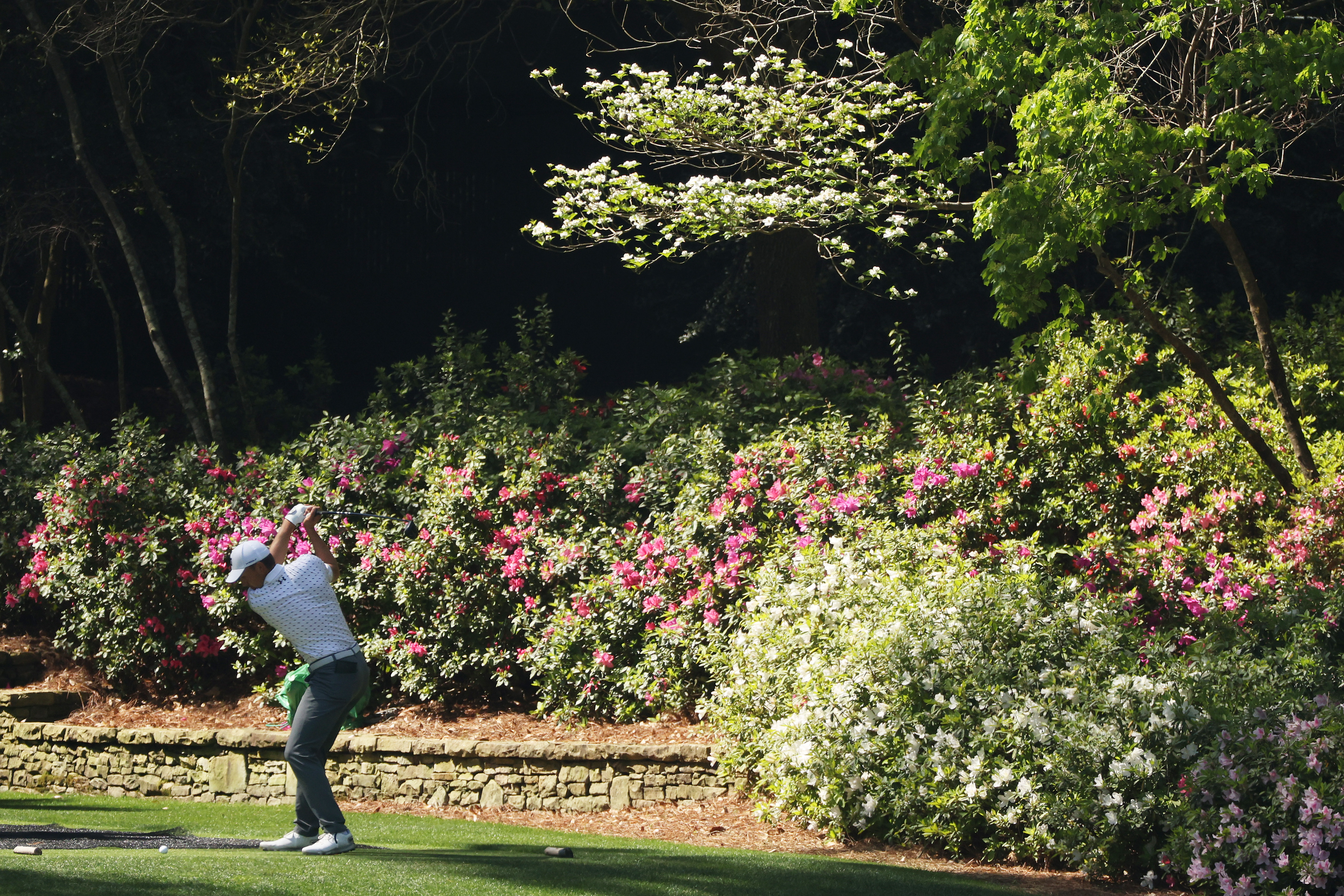 Jordan Spieth of the United States plays his shot from the 13th tee during a practice round prior to the Masters at Augusta National Golf Club on April 06, 2021 in Augusta, Georgia.